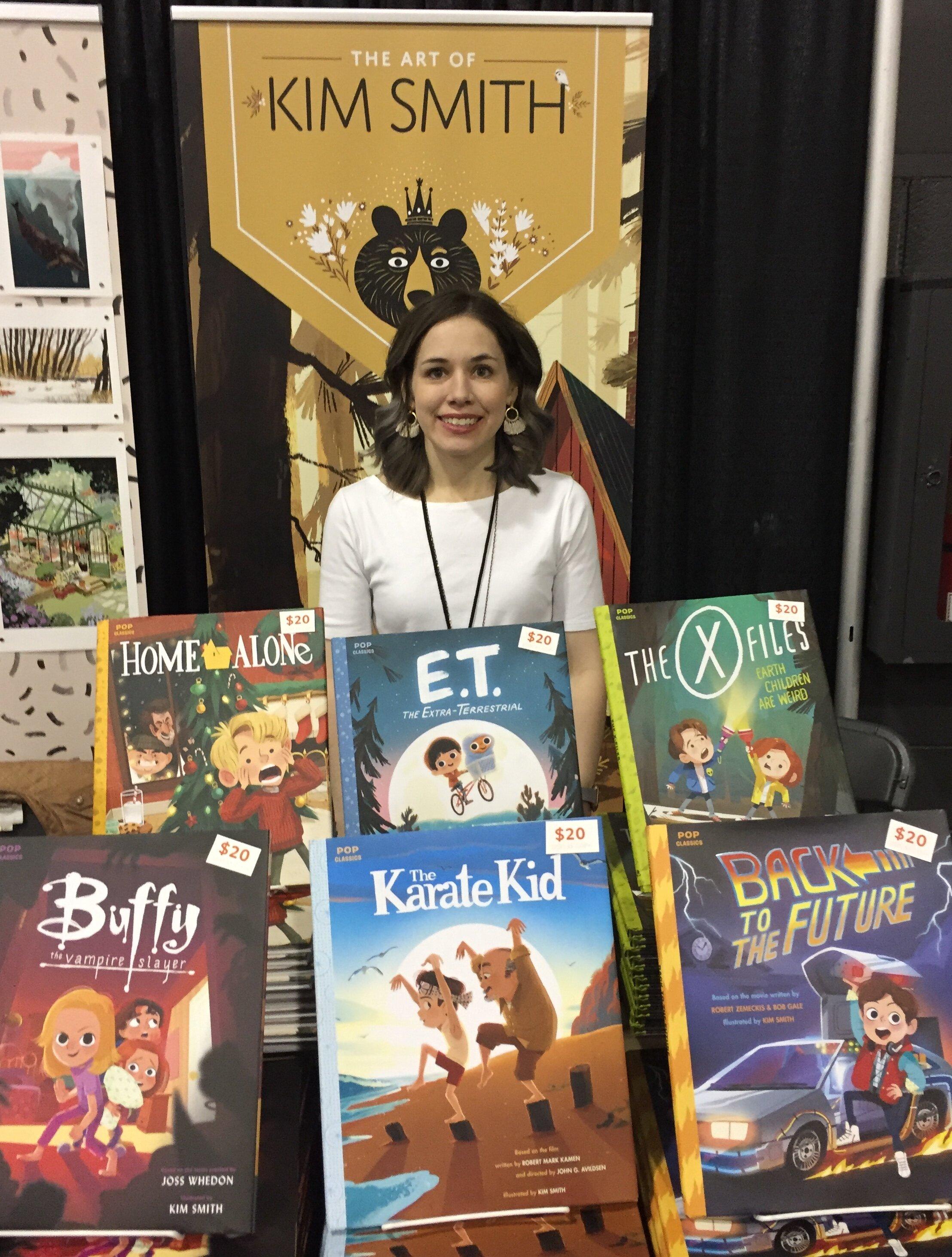 Illustrator, Kim Smith, at the 2019 Calgary Expo. (Photo credit: Charles Cousins/GeekNerdNet)