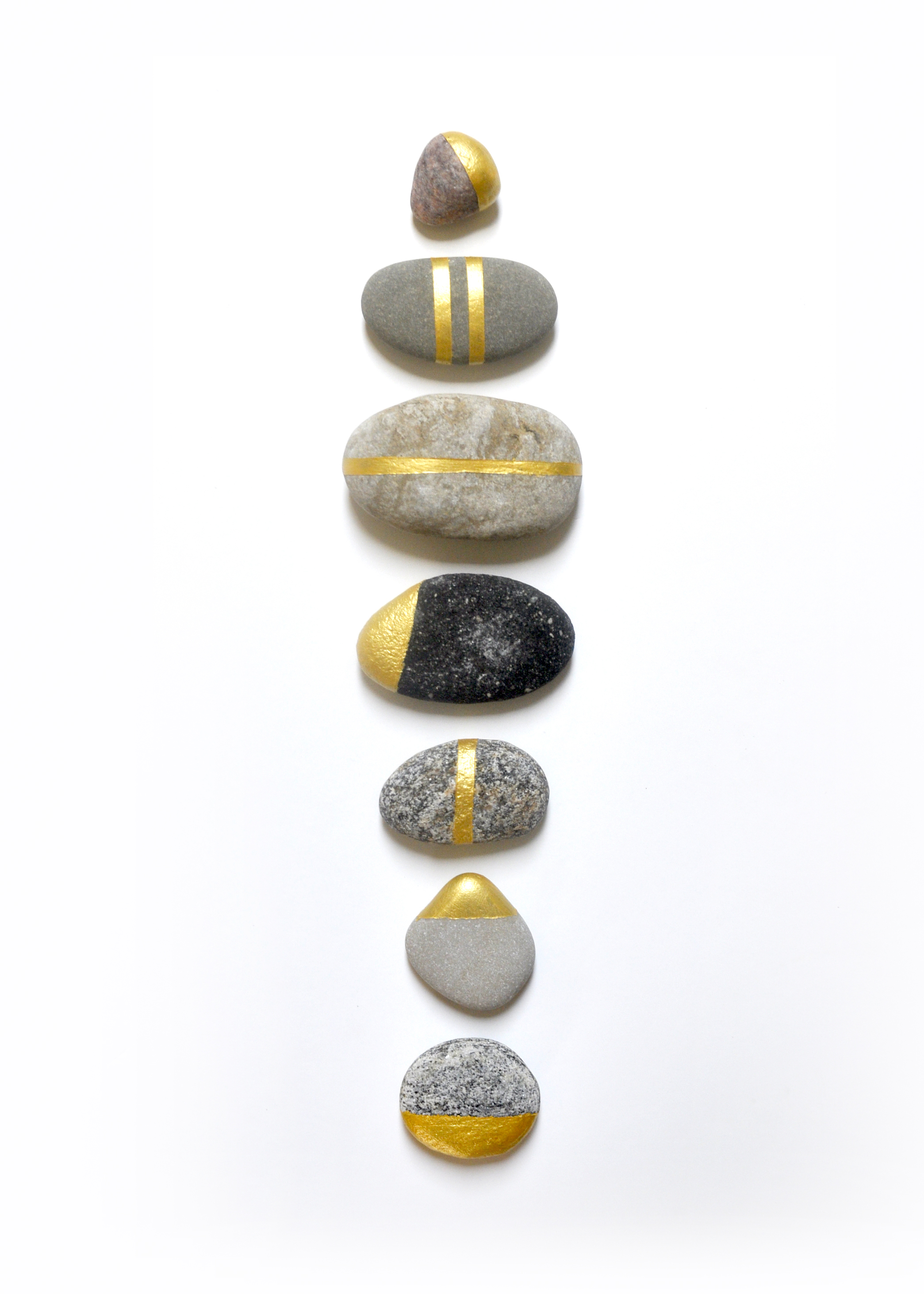 Gold painted rocks by Swell Made Co.