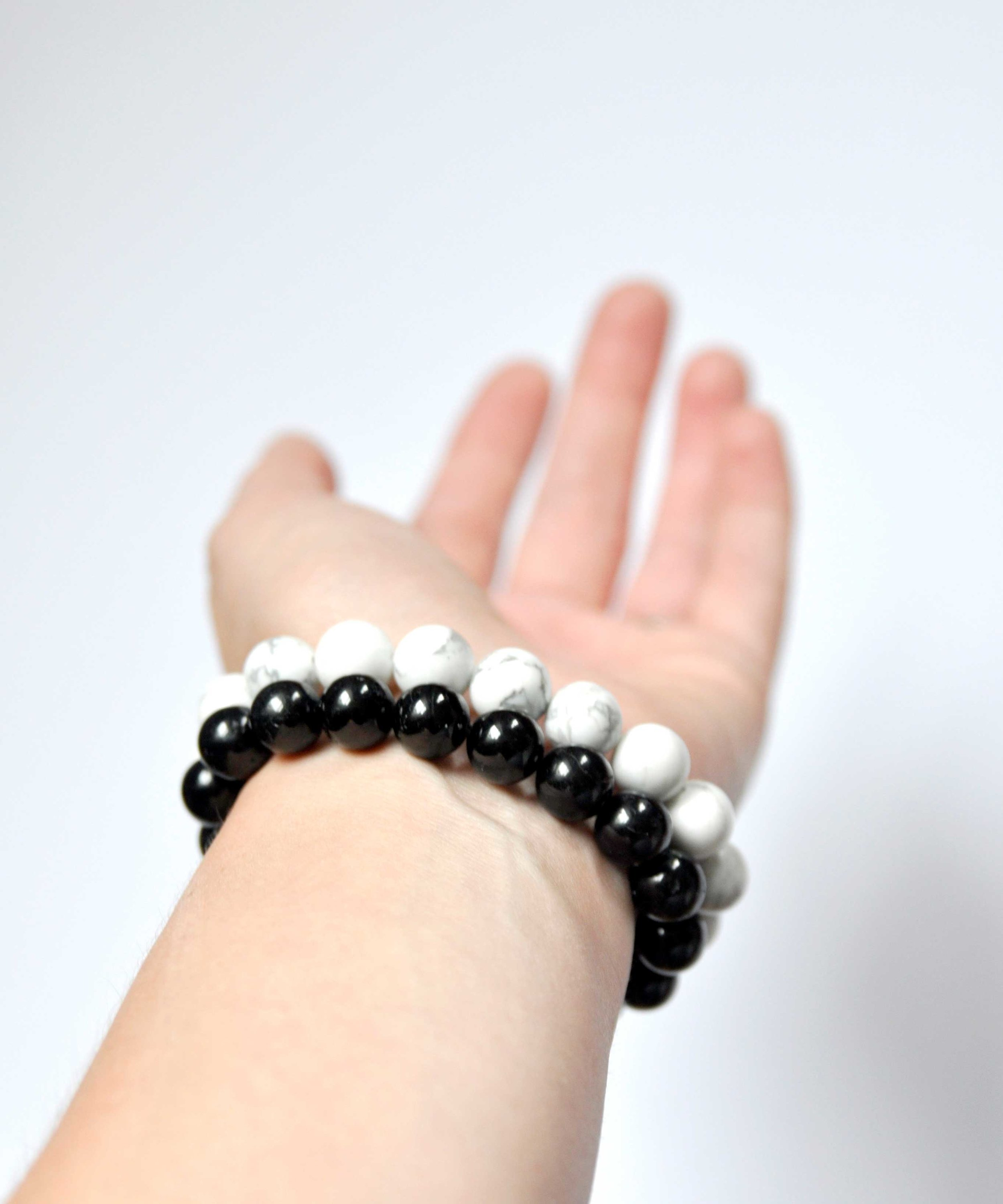 Healing crystal bracelets by Swell Made Co. x Breathing Inspiration. With black tourmaline and howlite stones.