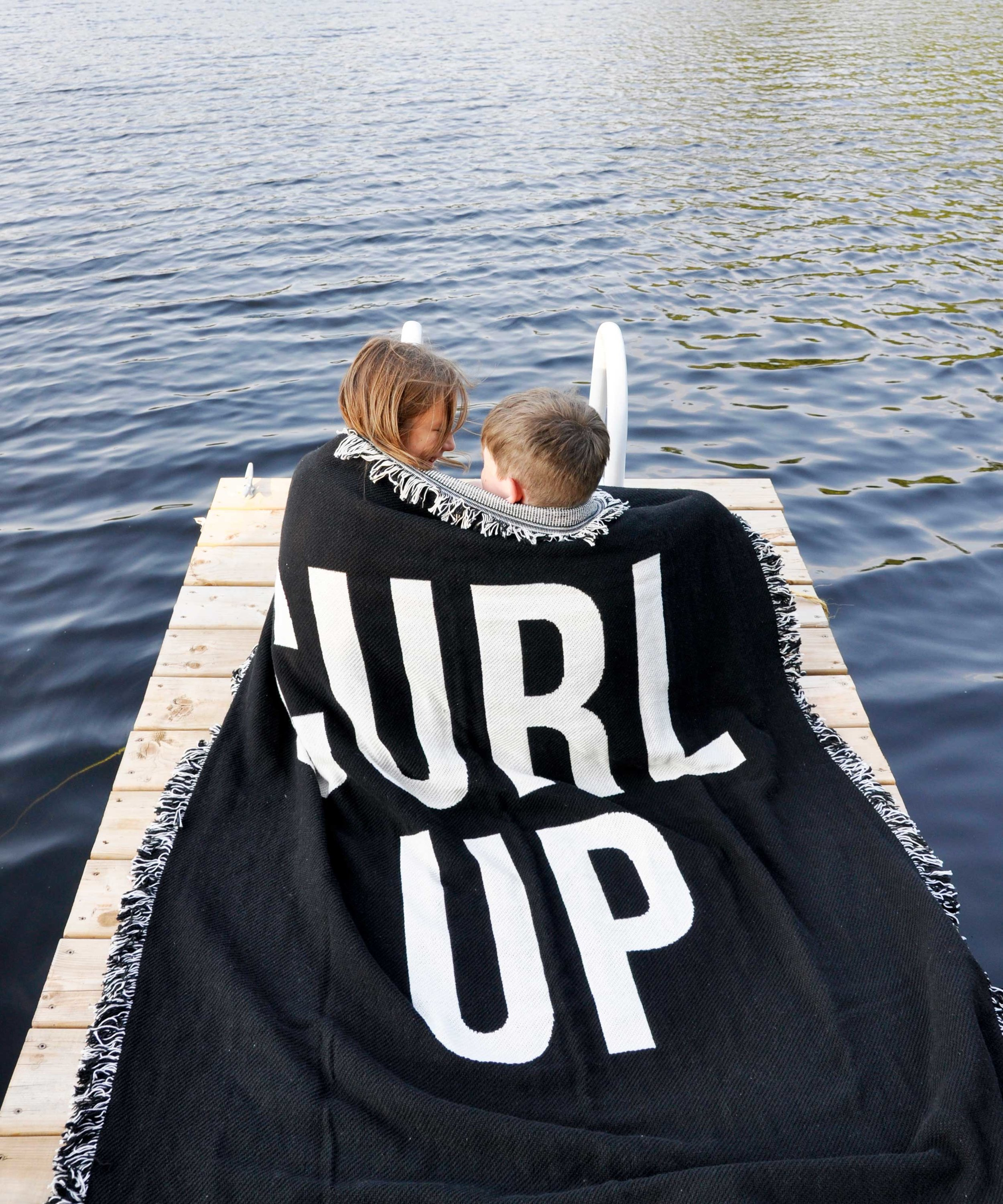 Curl Up cotton throw blanket    by Swell Made Co. Siblings curling up and making memories.