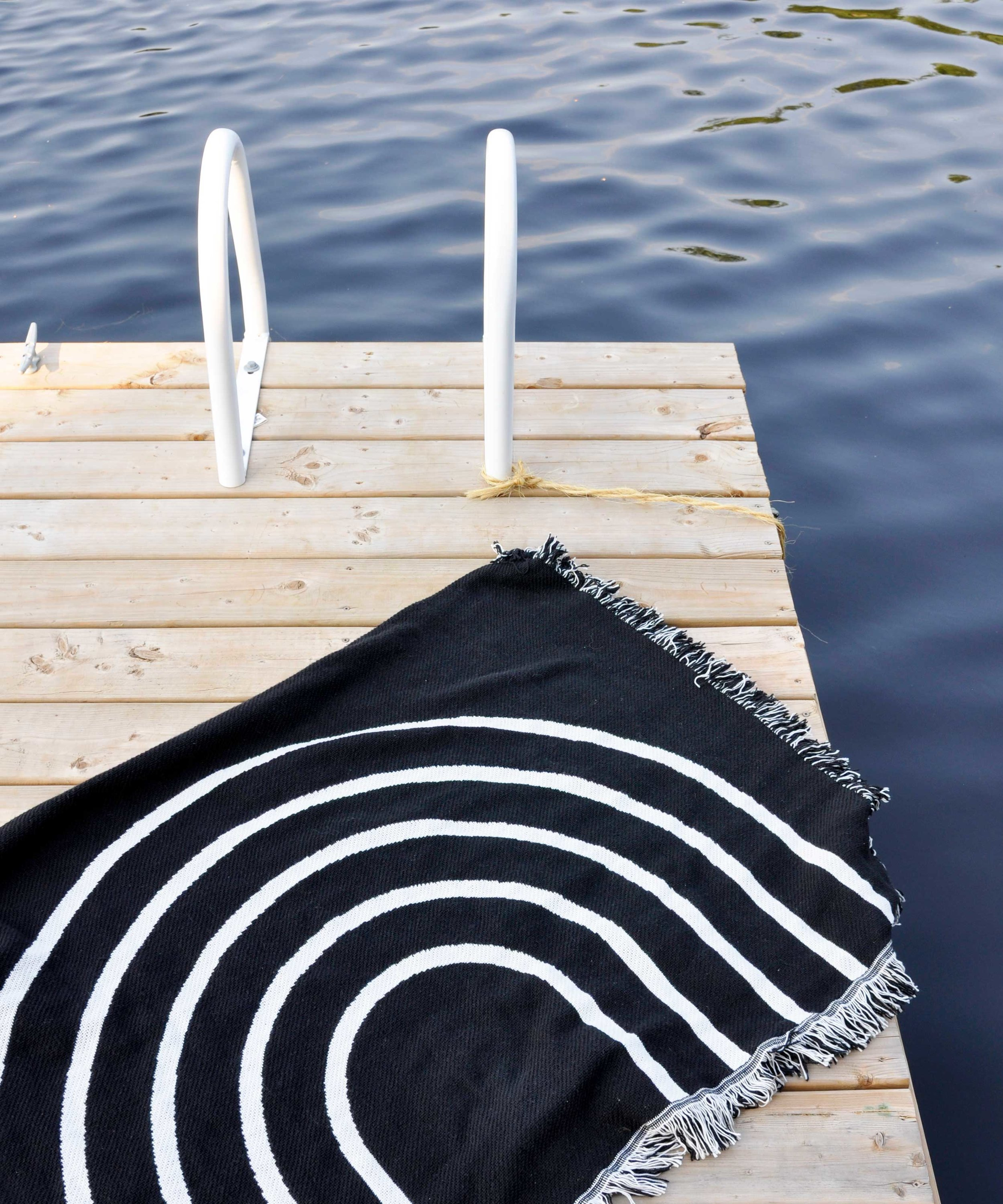 Rainbow cotton throw blanket    by Swell Made Co. Spread out on the dock or the beach for a day in the sun.