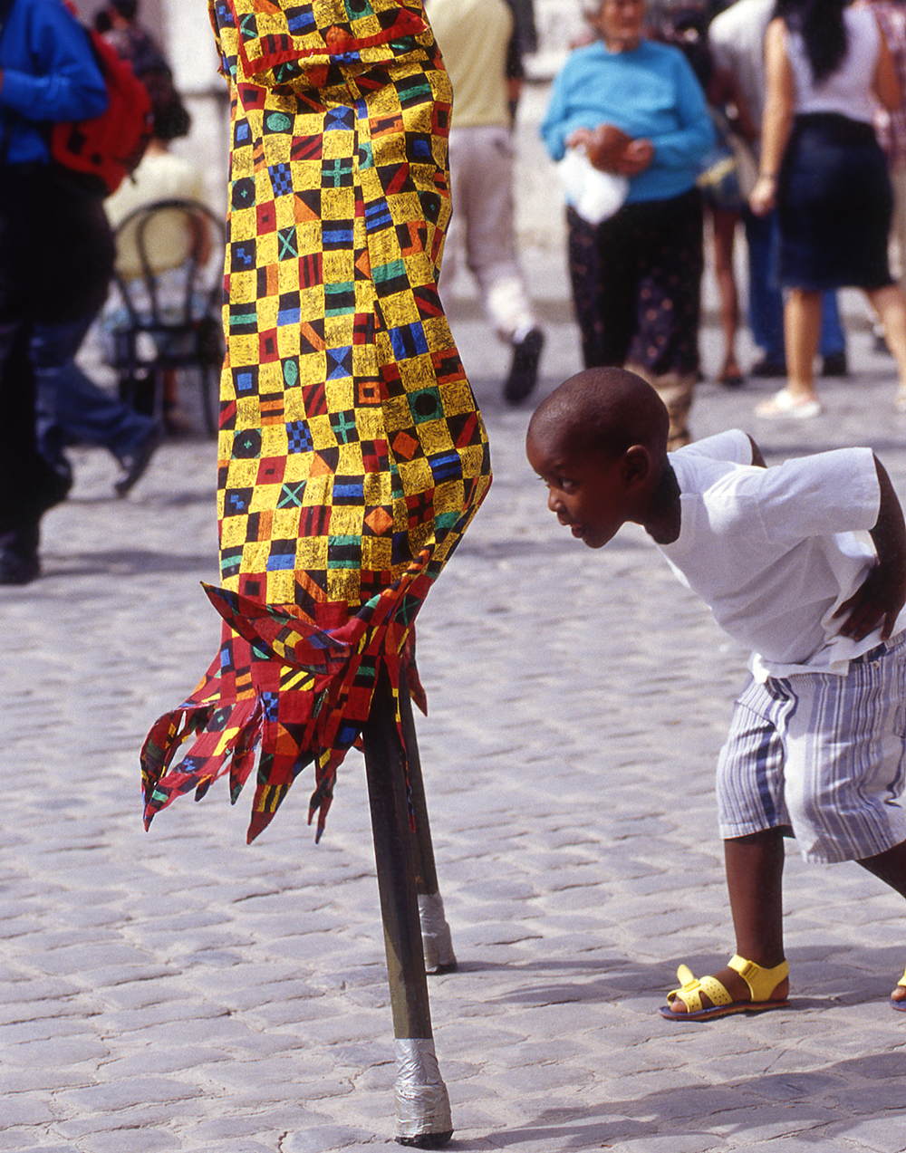 Boy Running Under Stilts