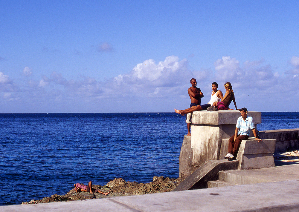 People Relaxing on Malecón