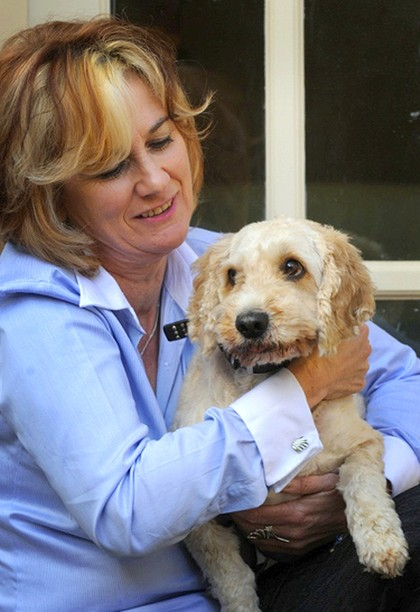 Not just a cute pooch ... Mary Jo McVeigh and Toby provide animal assistance therapy.