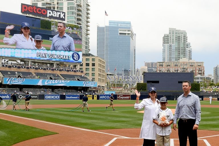 "Dr. Mona Mofid promoting ""play sun smart"" at petco Park with junior superstar Chris Evans and Former MLB player Mark Loretta"