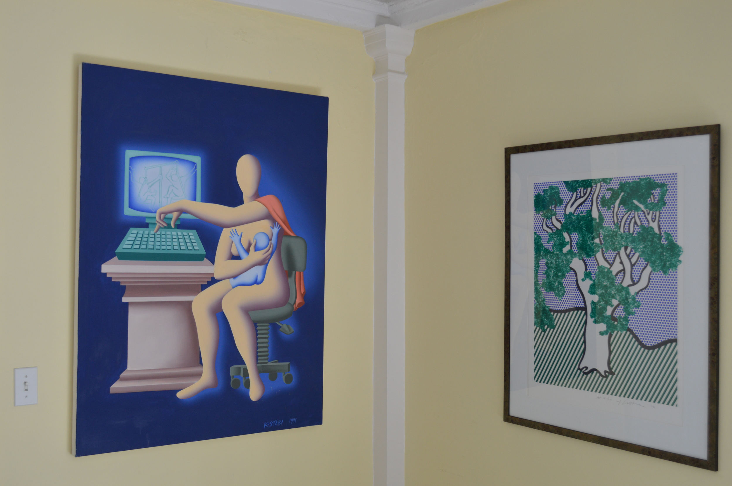 In 1991,Jodi Nassexplained to artist Mark Kostabi that technology was women's liberation; it allowed women to work while breastfeeding. Mark Kostabi painted the scene later that year. It pictures Jodi Nass working whilenursing Victory Club founder, Stephanie Nass.