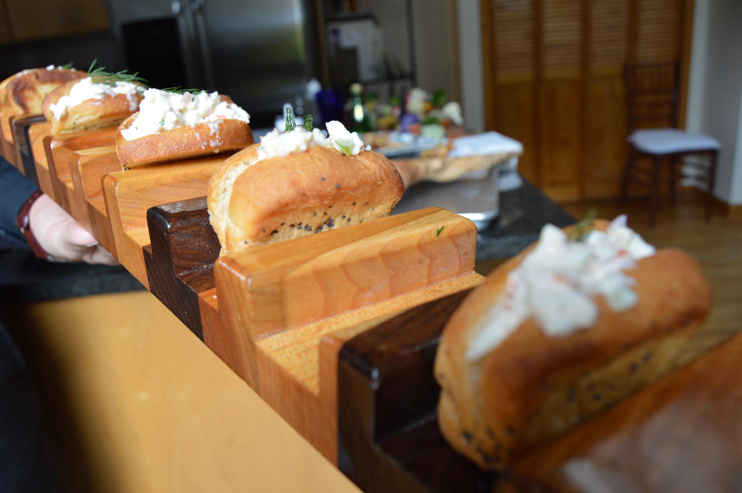 Miniature lobster rolls, served on a platterdesigned by Paul Neuman