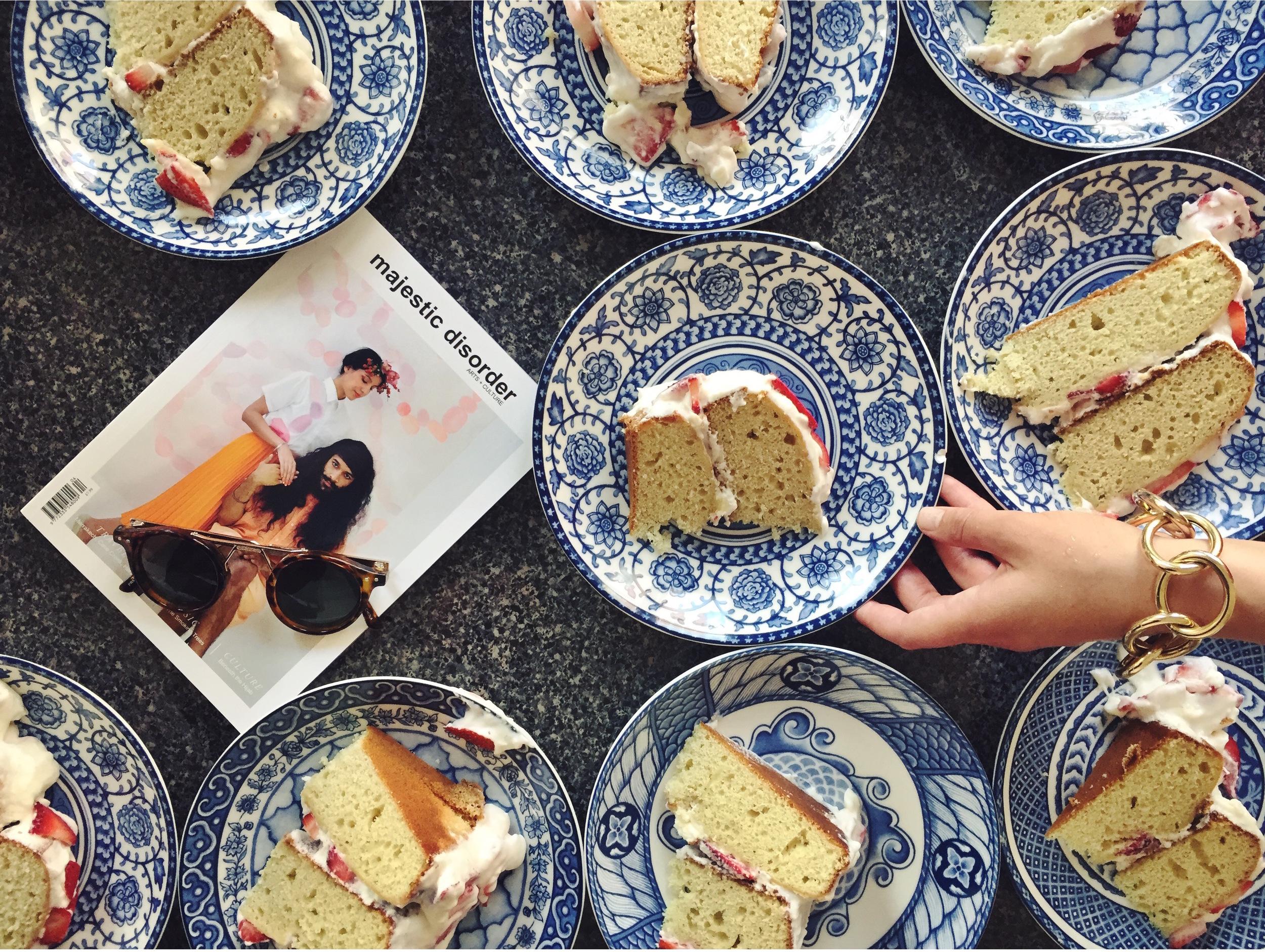 Stephanie plating strawberry shortcake with majestic disorder magazine Issue IV (image via  @majesticdisorder )