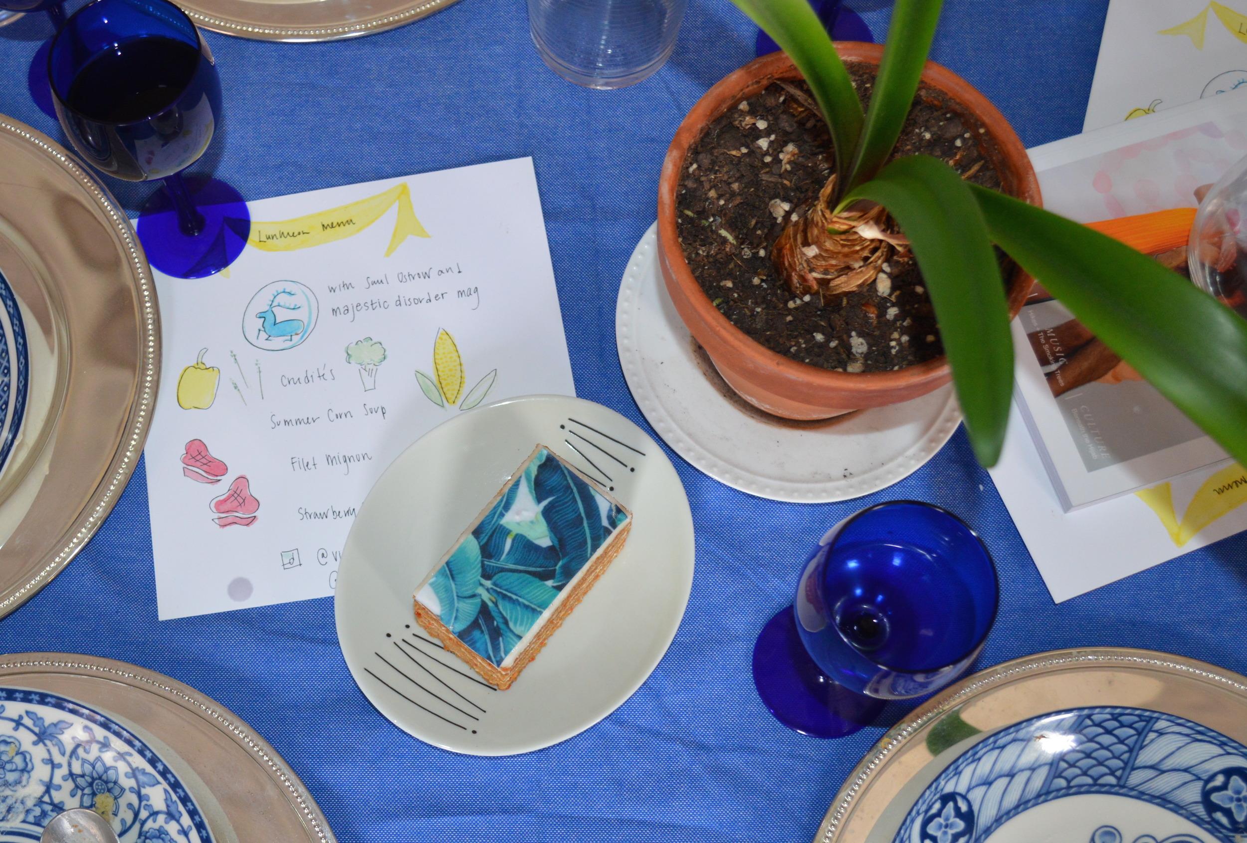 Palm leaf carrot cake below palm leaf centerpieces.