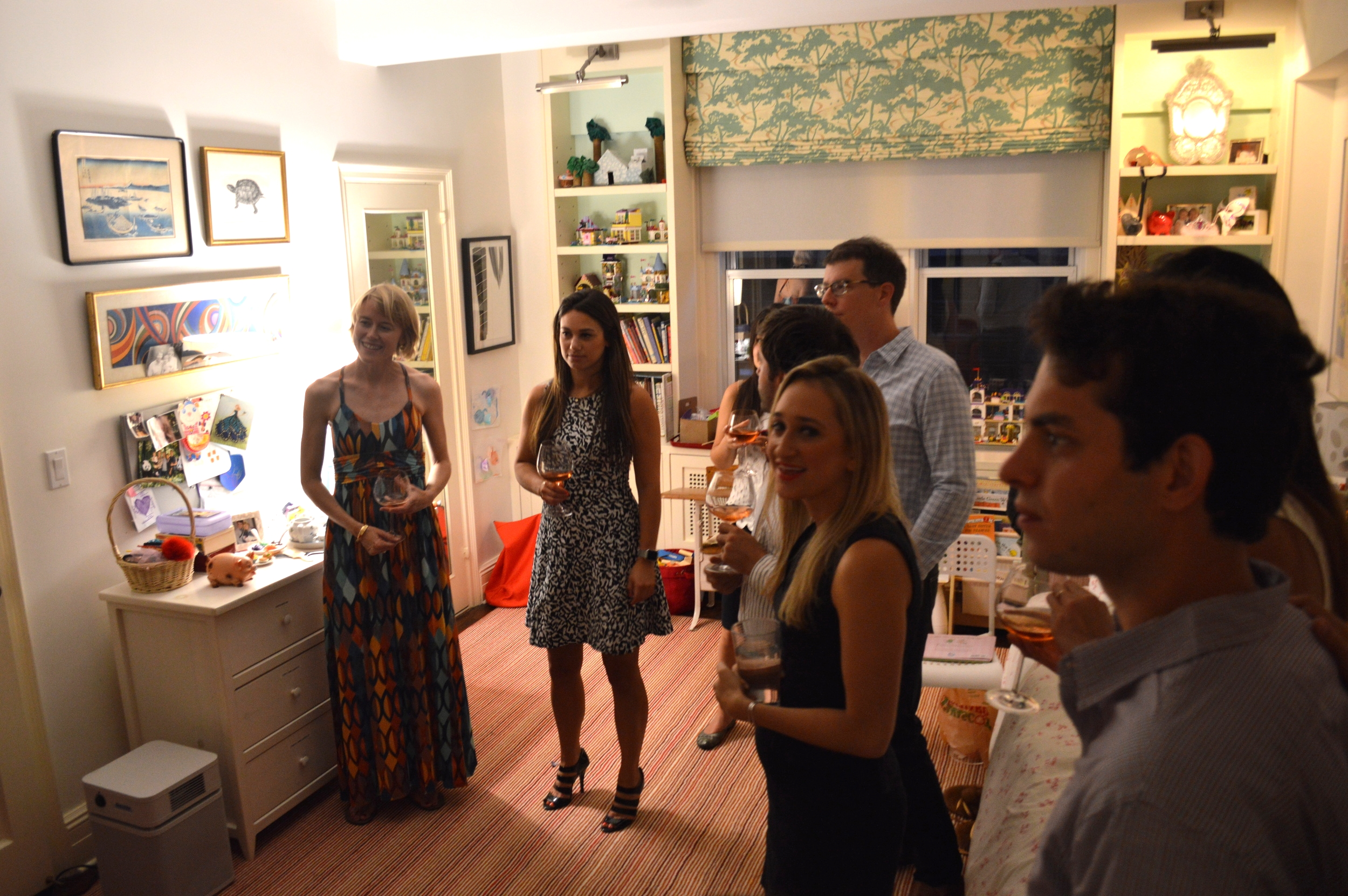 Members and guests learning about the Geary's private art collection at their home in Manhattan