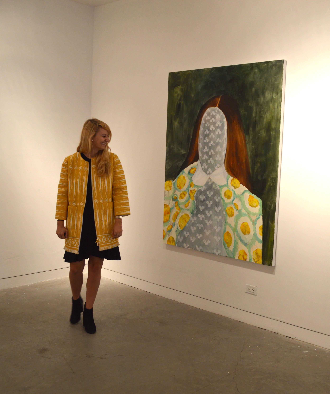 Margaret Lefton observing the artwork.