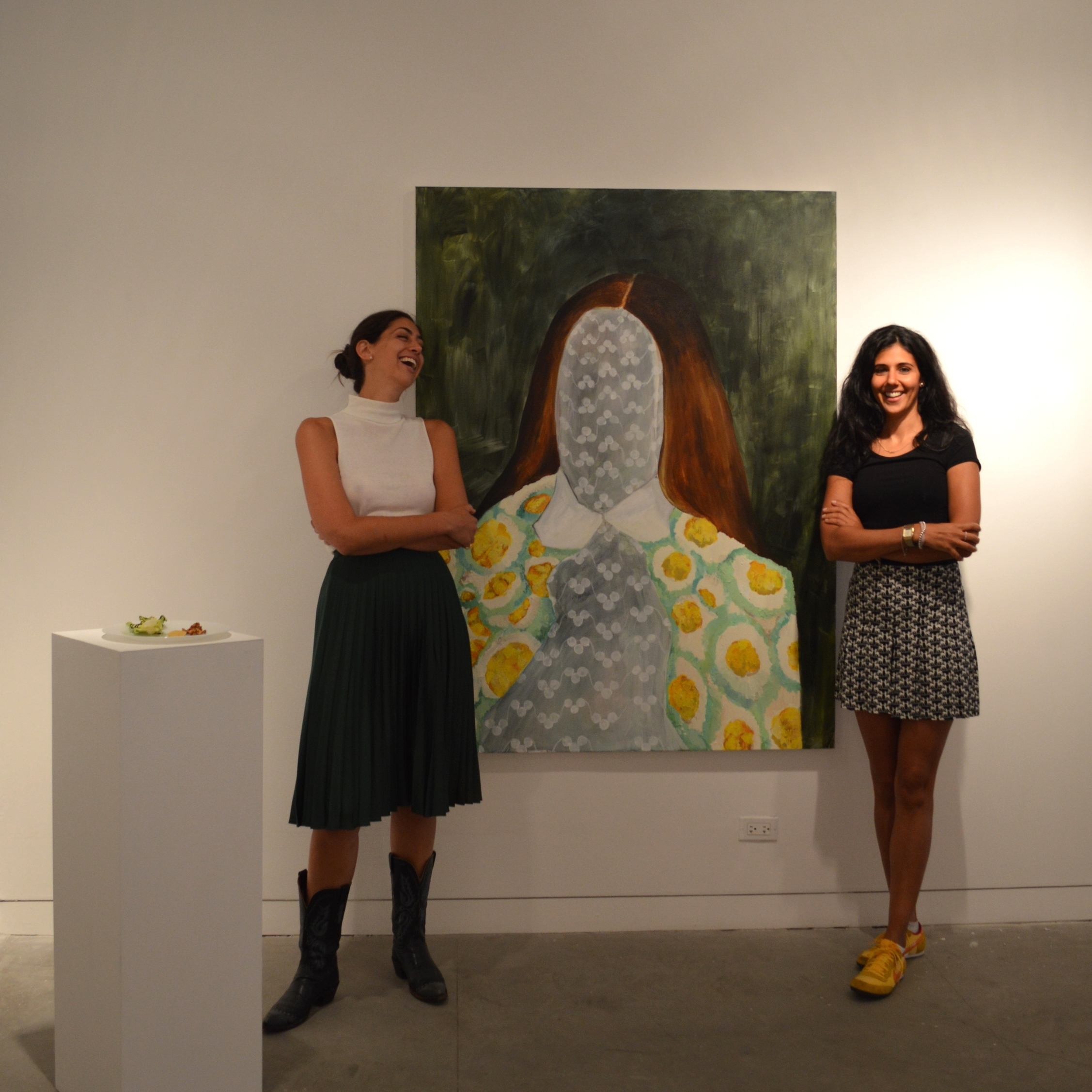 Stephanie Nass and Jennifer Louise Martin standing by their respective artworks
