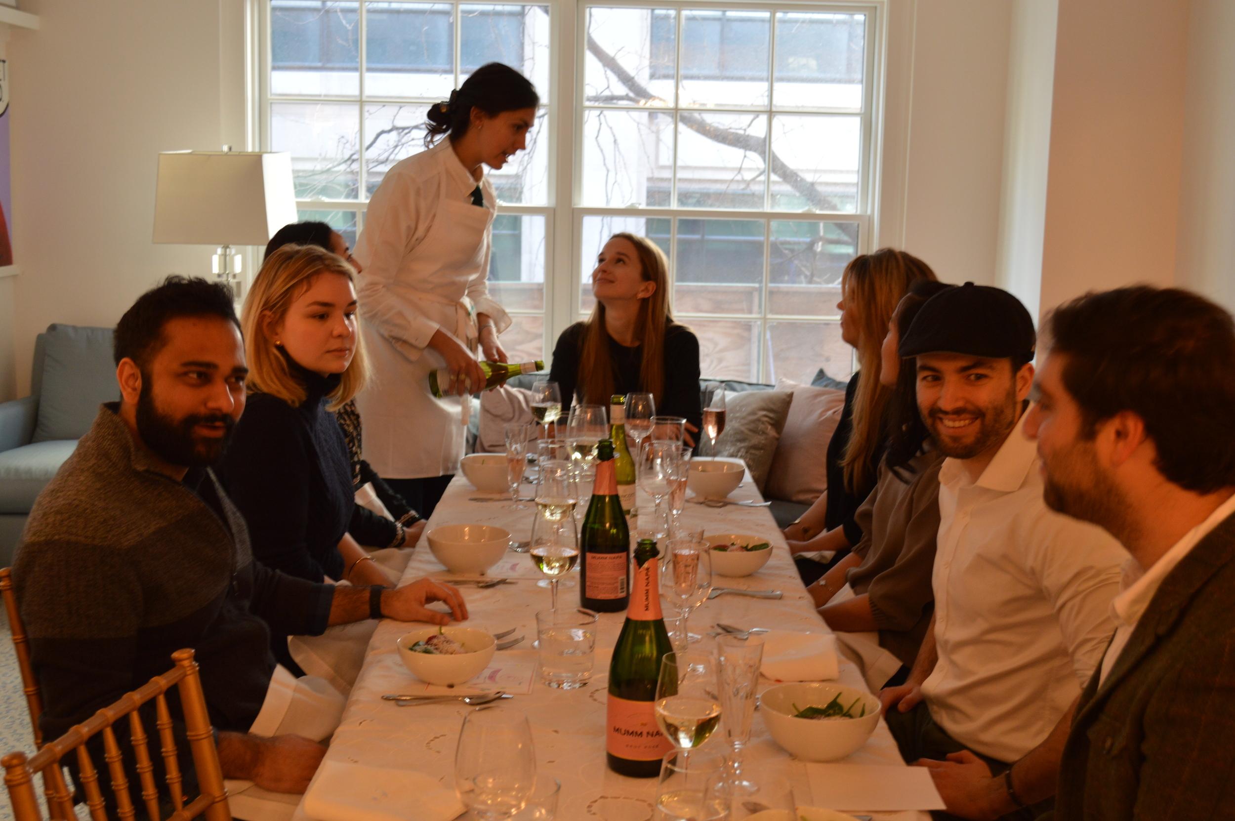 """Chefanie"" and Kristin talking over orange salad and Mumm Napa Rosé"