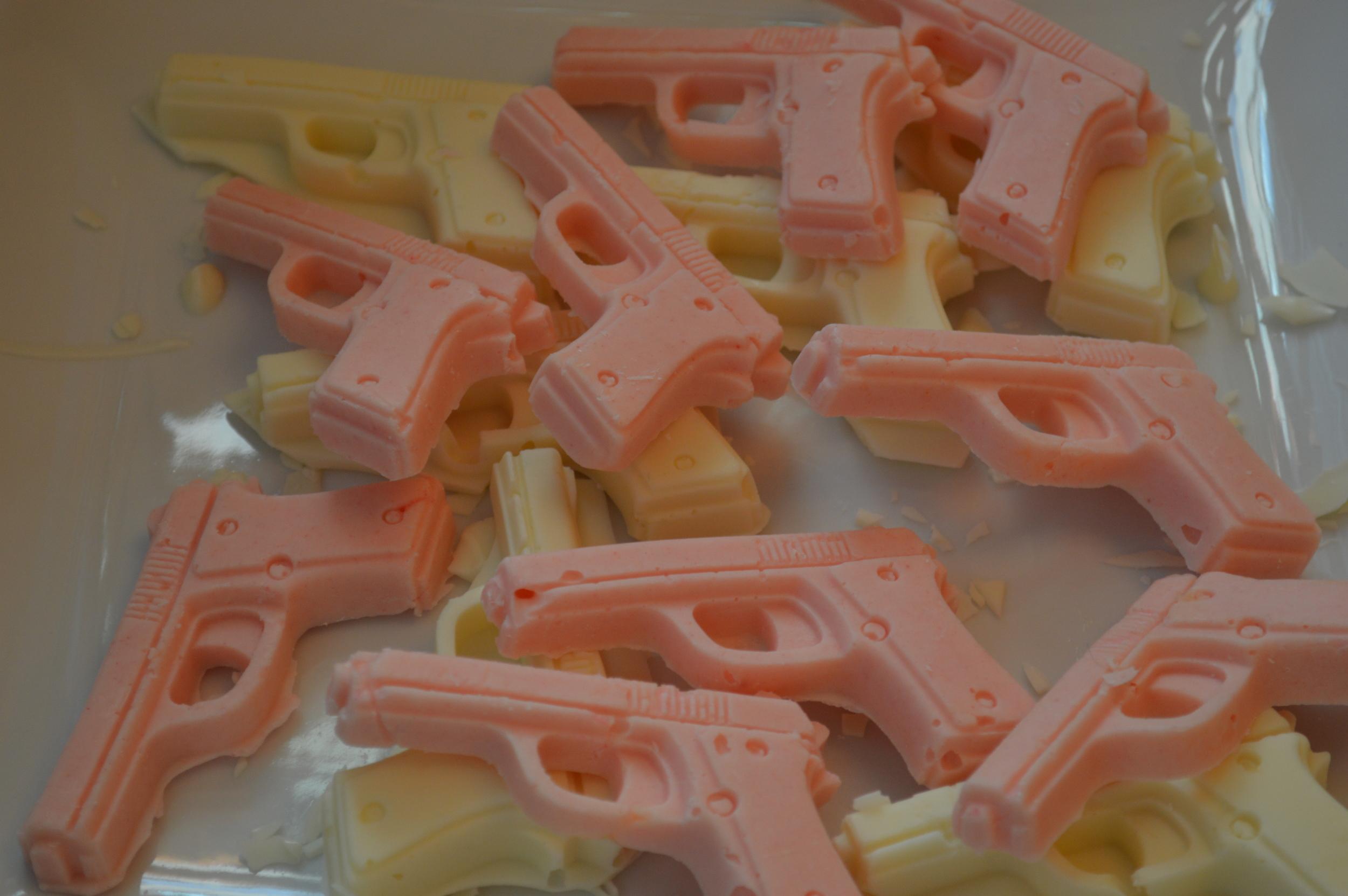 White chocolate guns to garnish ice cream sundaes referencing Kristin's work with the Second Amendment