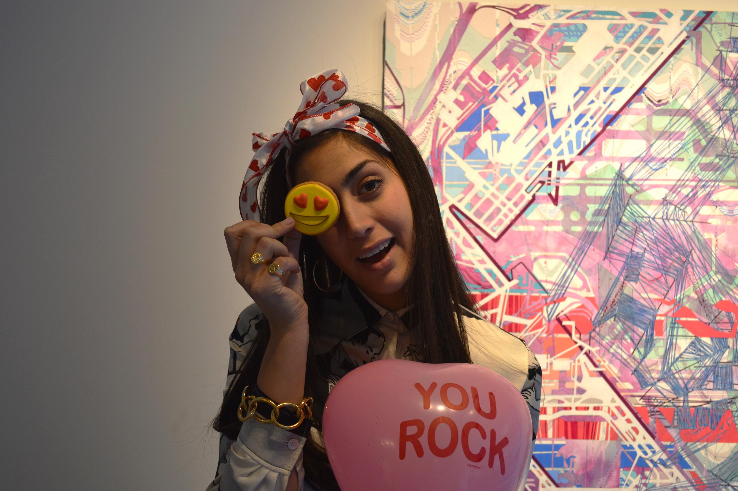 "Chefanie holding Eleni's ""Emoji in Love Cookie"""