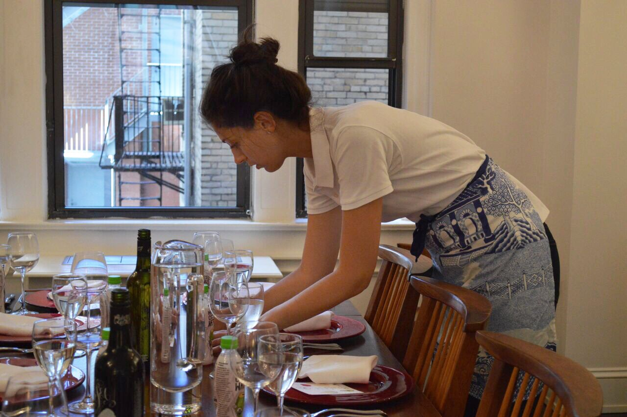 Chefanie putting the finishing touches on the tablescape