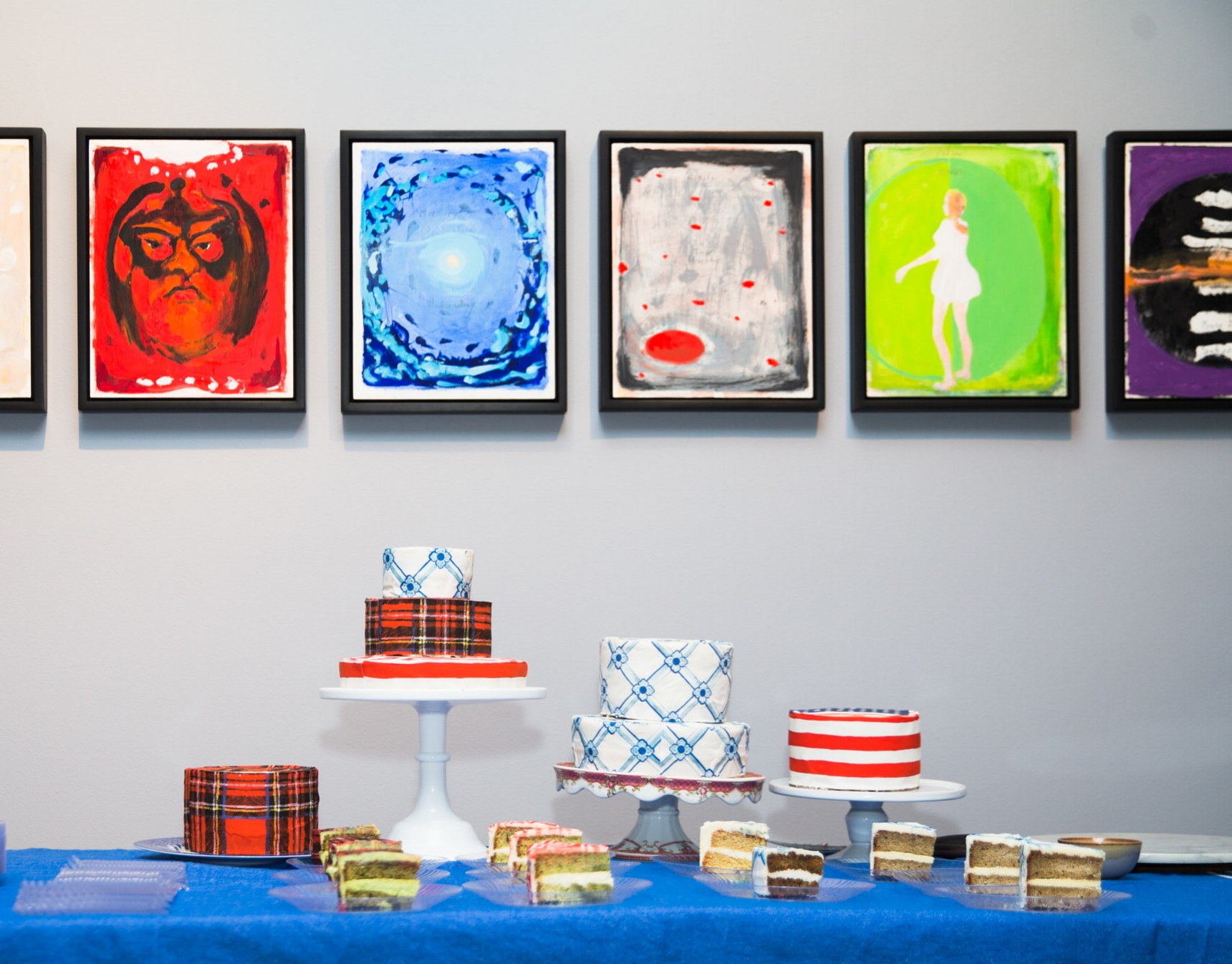 Cake with  Chefanie Sheets  in front of Verne Dawson series at Dickinson Roundell. Photo credit: Noa Griffel for BFA