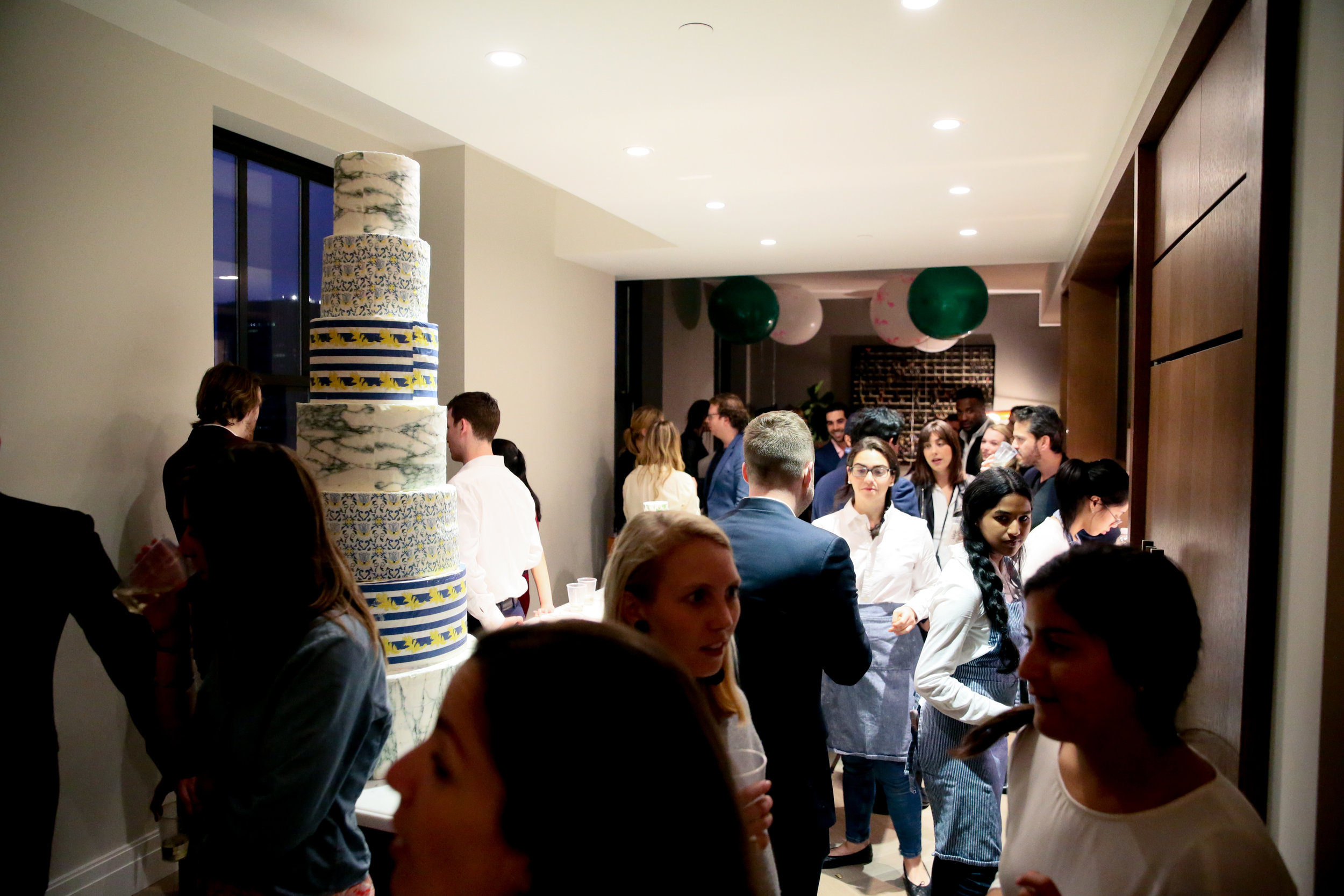 Victory Club members enjoying the view of a 6ft cake covered with Chefanie sheets