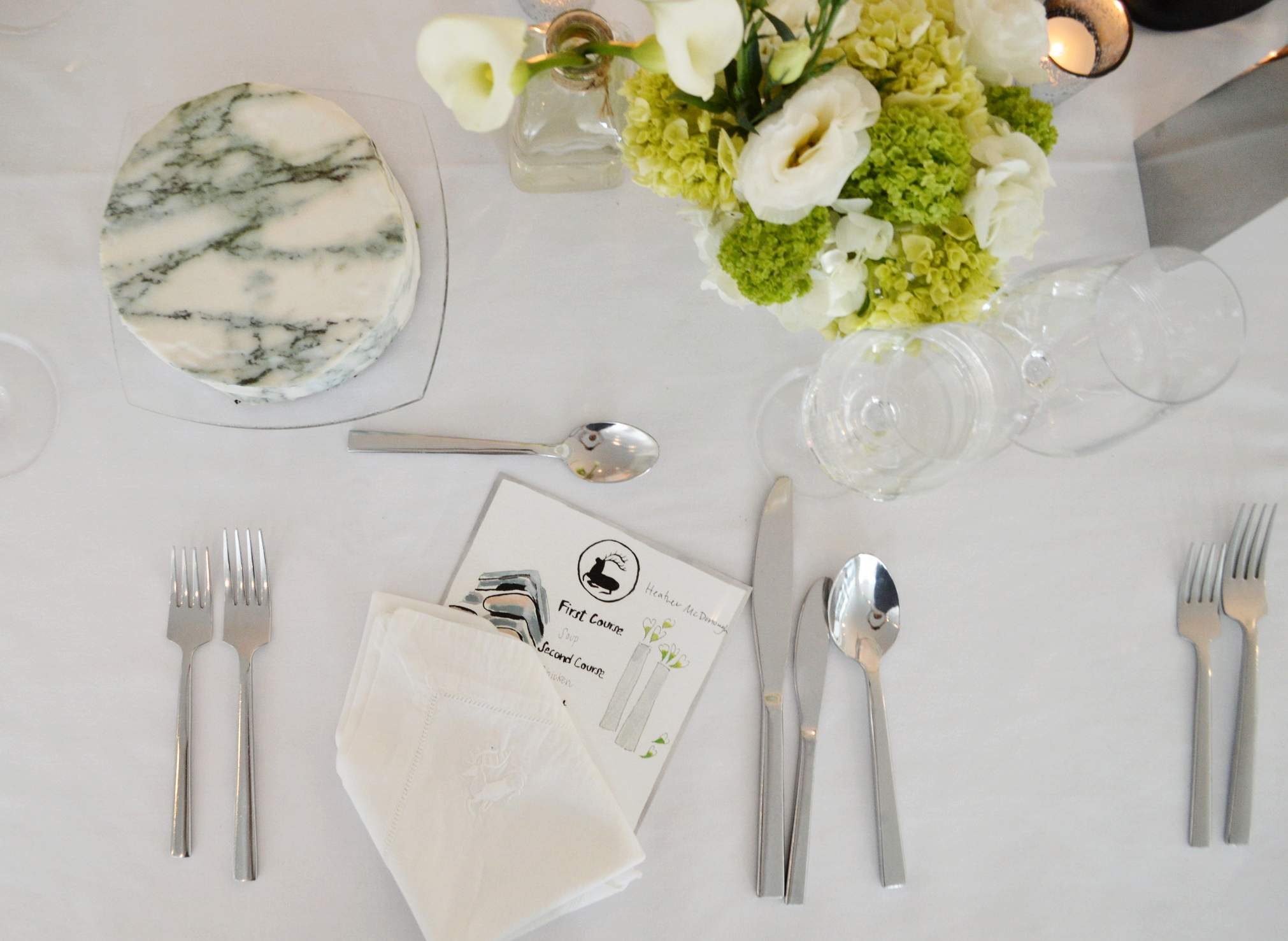 Tablescape at the Avenue Magazine dinner held at  Zaha Hadid 520 W 28th Street  including a  Chefanie Sheet  inspired by Hadid's works, a hand painted menu painted by Chefanie herself,vases designed by Zaha Hadid for Alessi, and flowers by  Mark Masone .