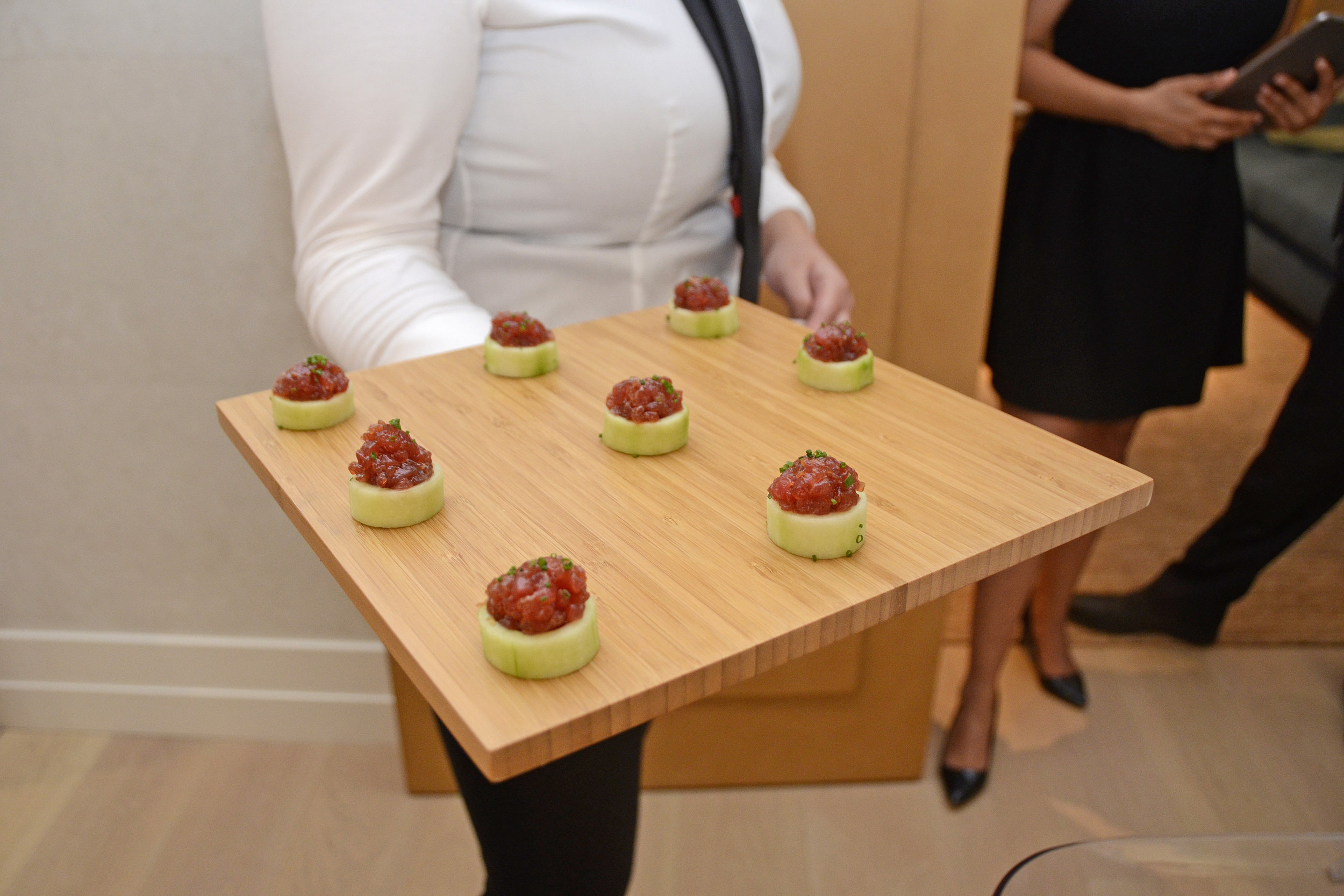 Fresh bite-sized tuna tartare served in cucumber cups. Credit: Lukas Greyson