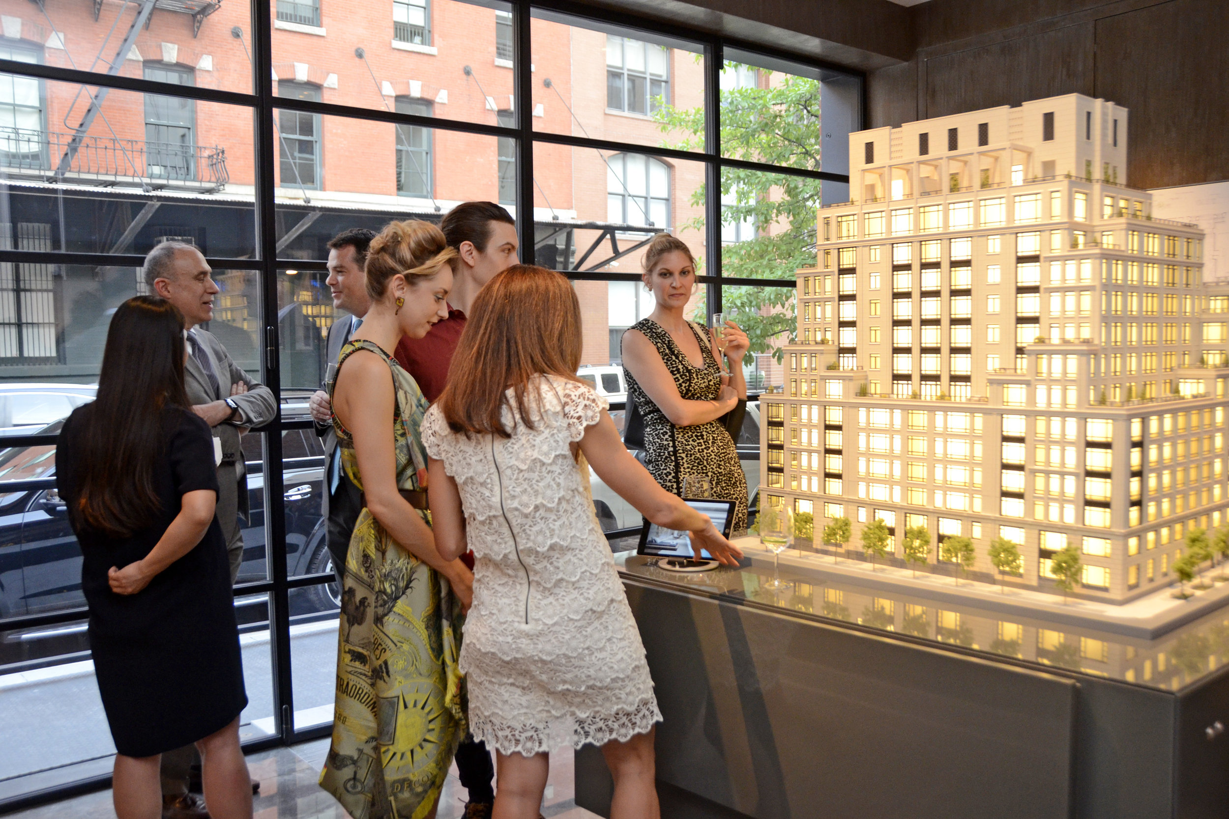Guests observing the model and virtual tour of 70 Vestry Street. Credit: Lukas Greyson