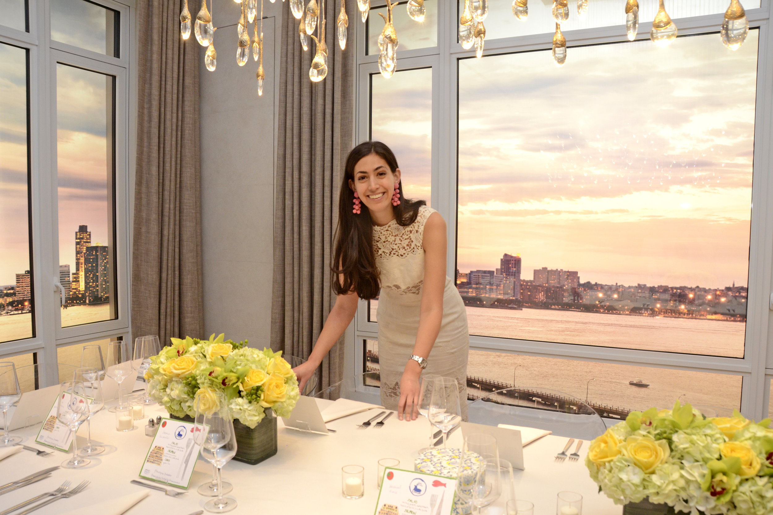 Chef Stephanie Nass setting the beautiful tablescape. Credit: Lukas Greyson
