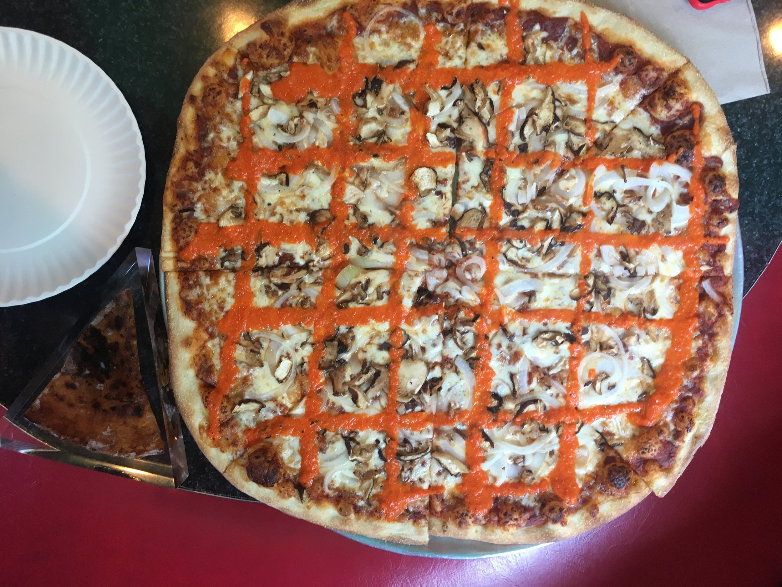 """The """" Tony Clifton """" pizza pie served at  Two Boots Pizza ."""