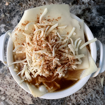 Cheese on soup prior to broiling