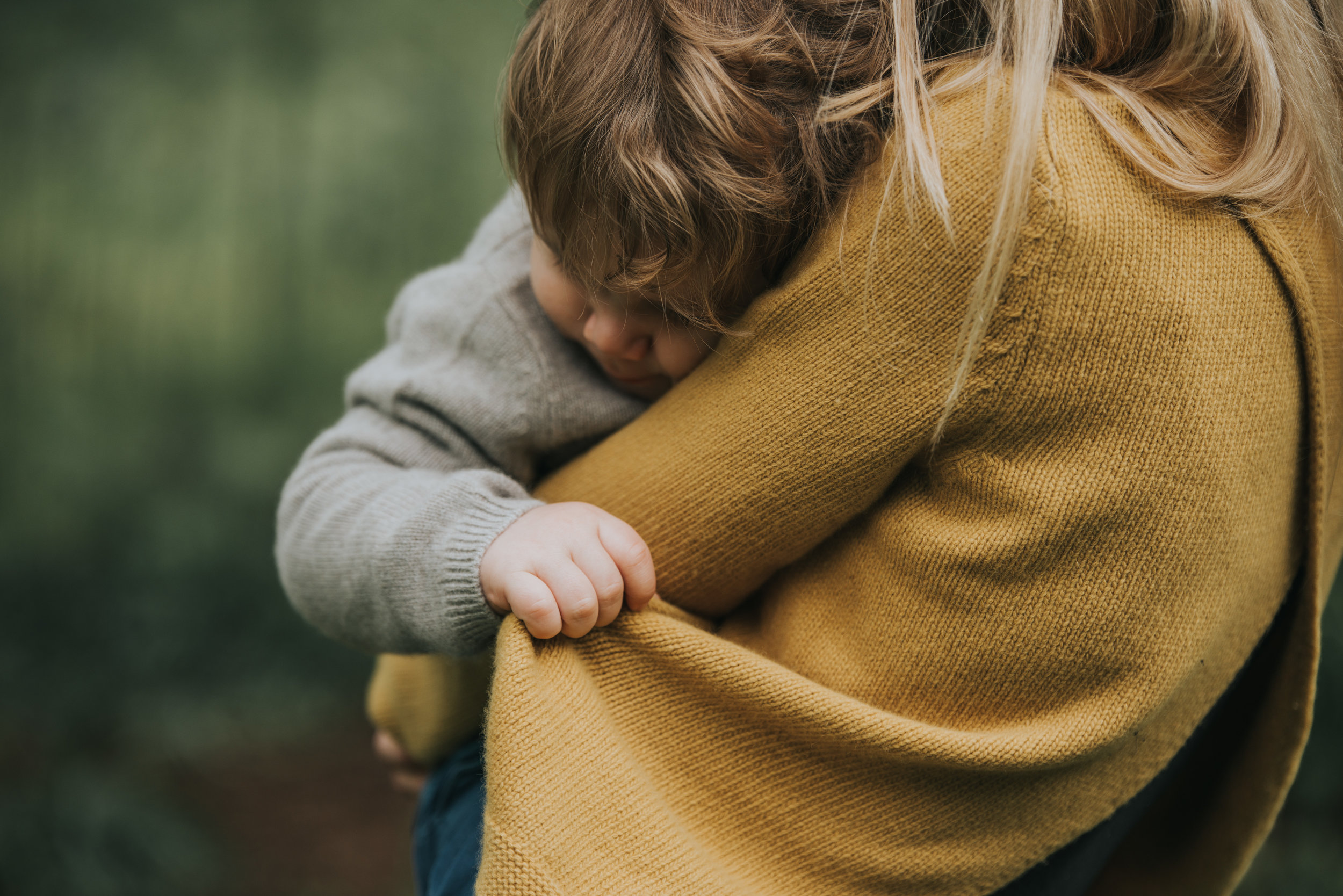 I love the emotion in this image, Ted looks so comforted by being in his mother's arms.