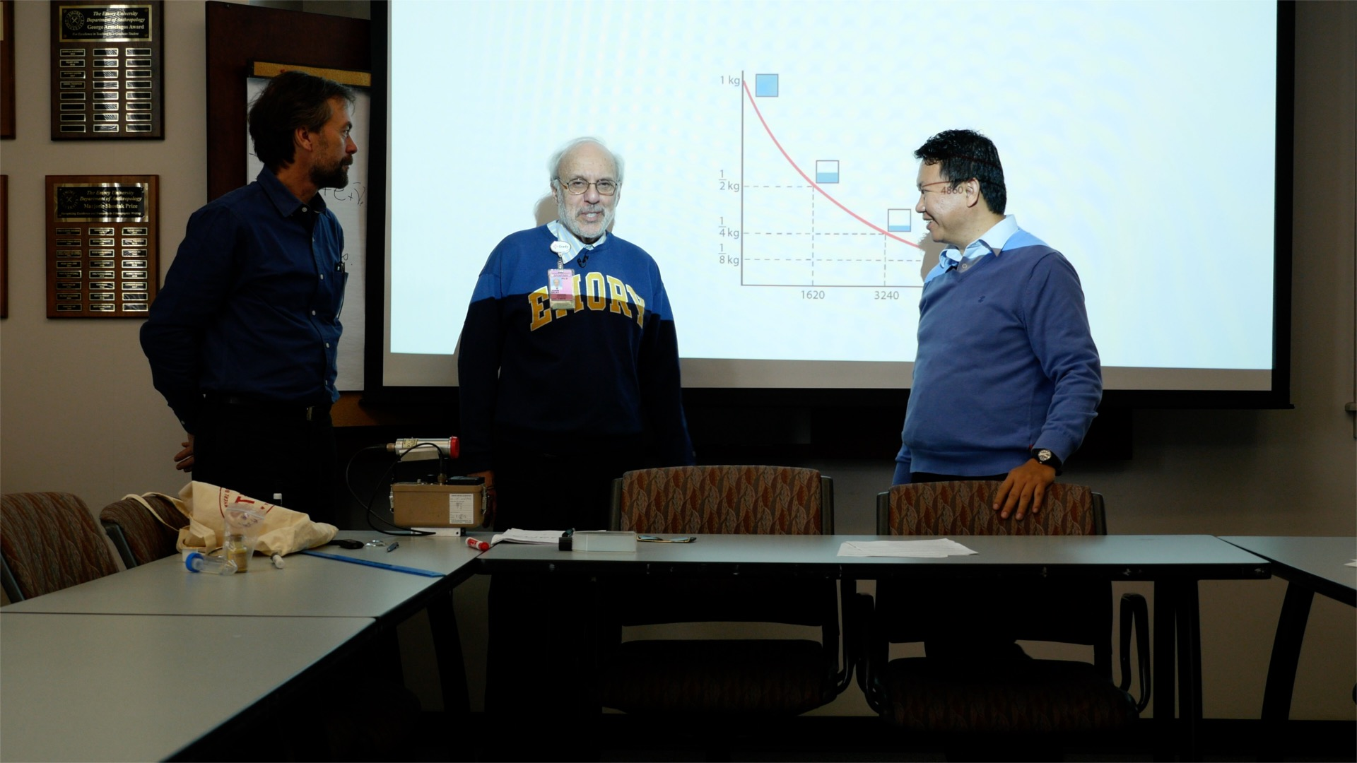 (from left) H. Jacobs with physicist John Malko and interpreter Tsondue Samphel.