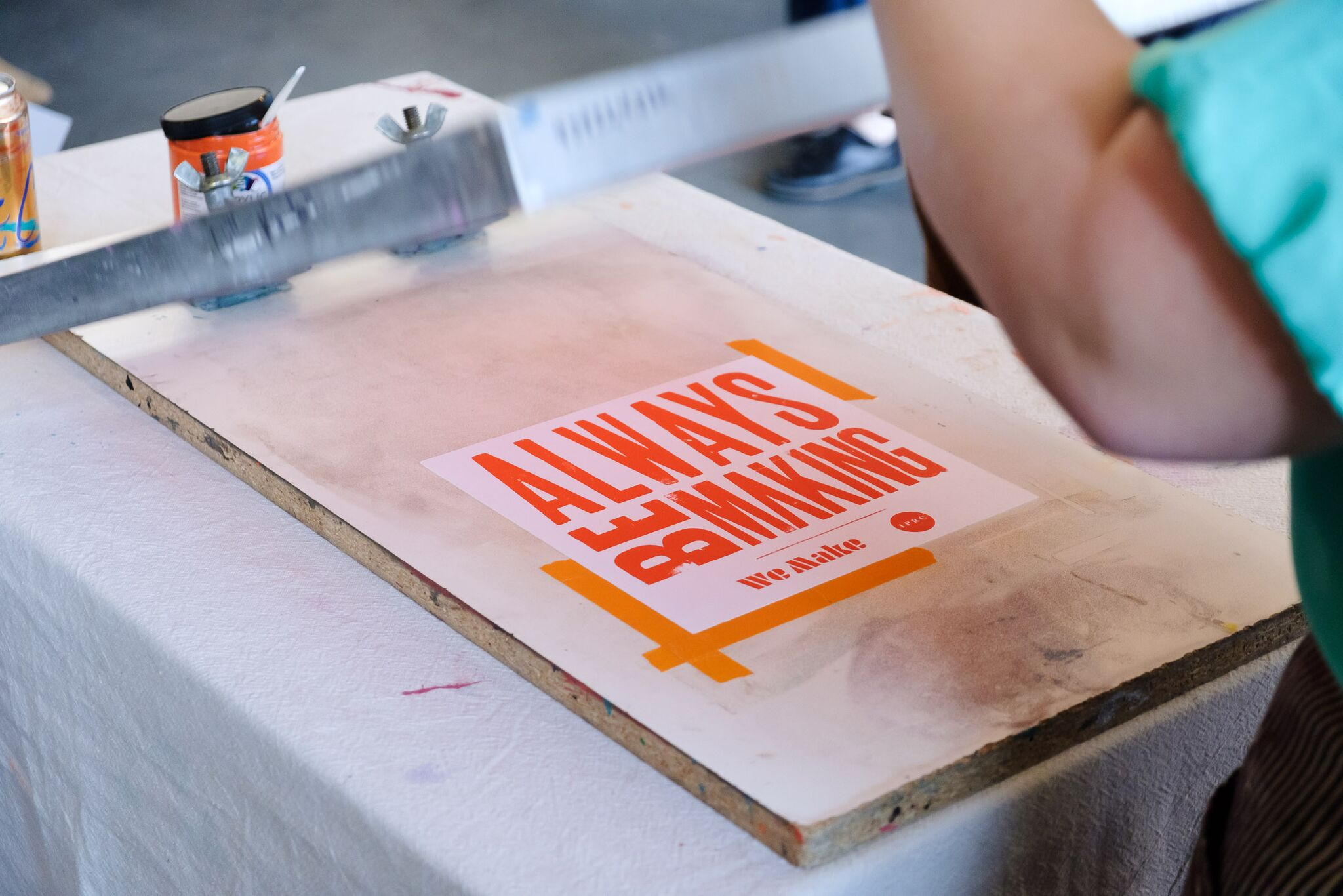 IPRC helped folks make their own screen print at our lettering show, 26.