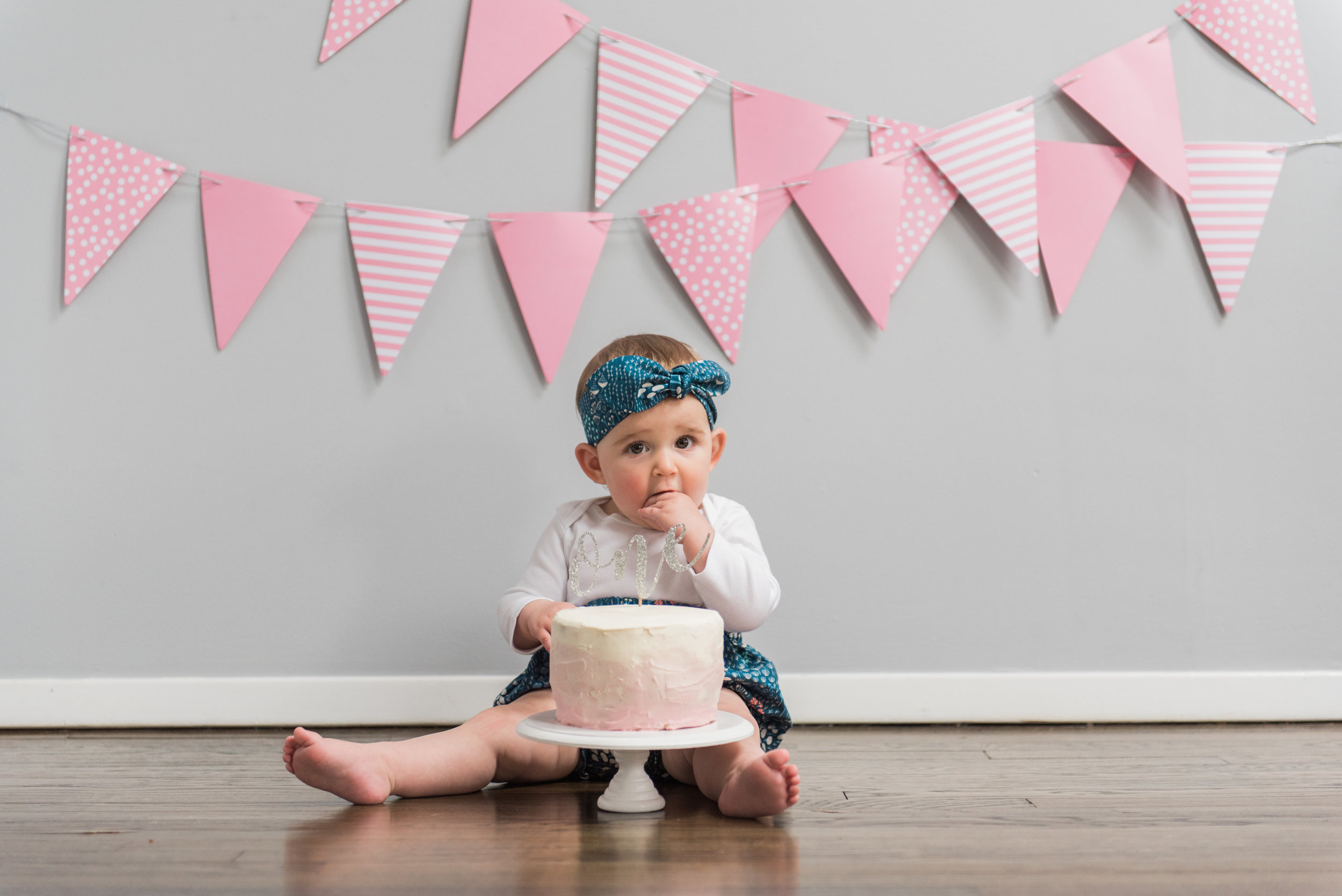 The latest trend in celebrating a baby's 1st birthday is the cake smash. To do it you set up a spot on the floor with a small birthday cake, a baby and let the smashing begin!