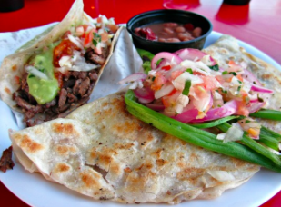 Chicken Vampiro   A quesadilla filled with meat, Mexican cheese, and roasted garlic sauce.