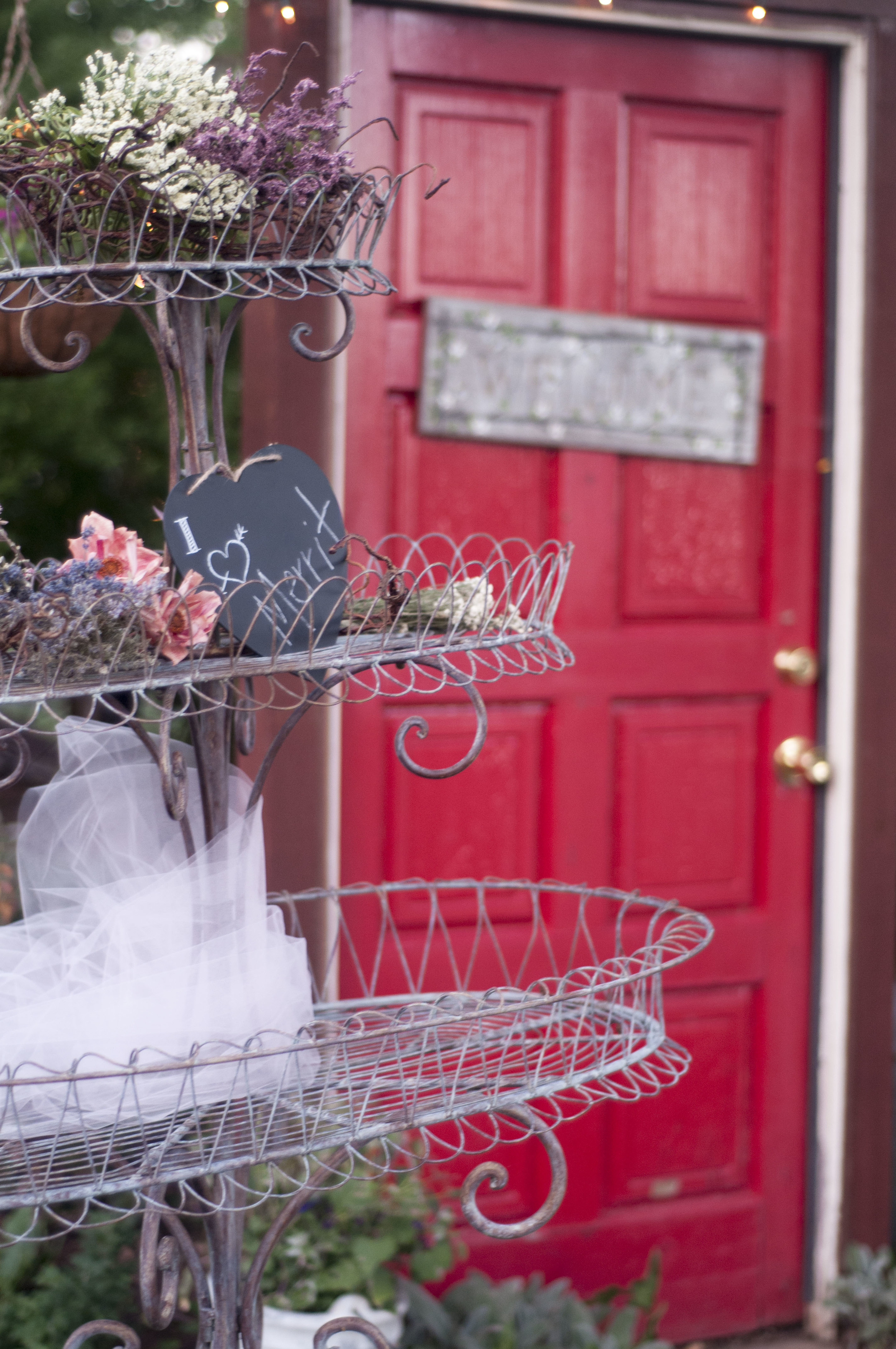 You just can't have a wedding at Shaffer Ranch without loving this staple red door at the entry way, it's pretty famous!