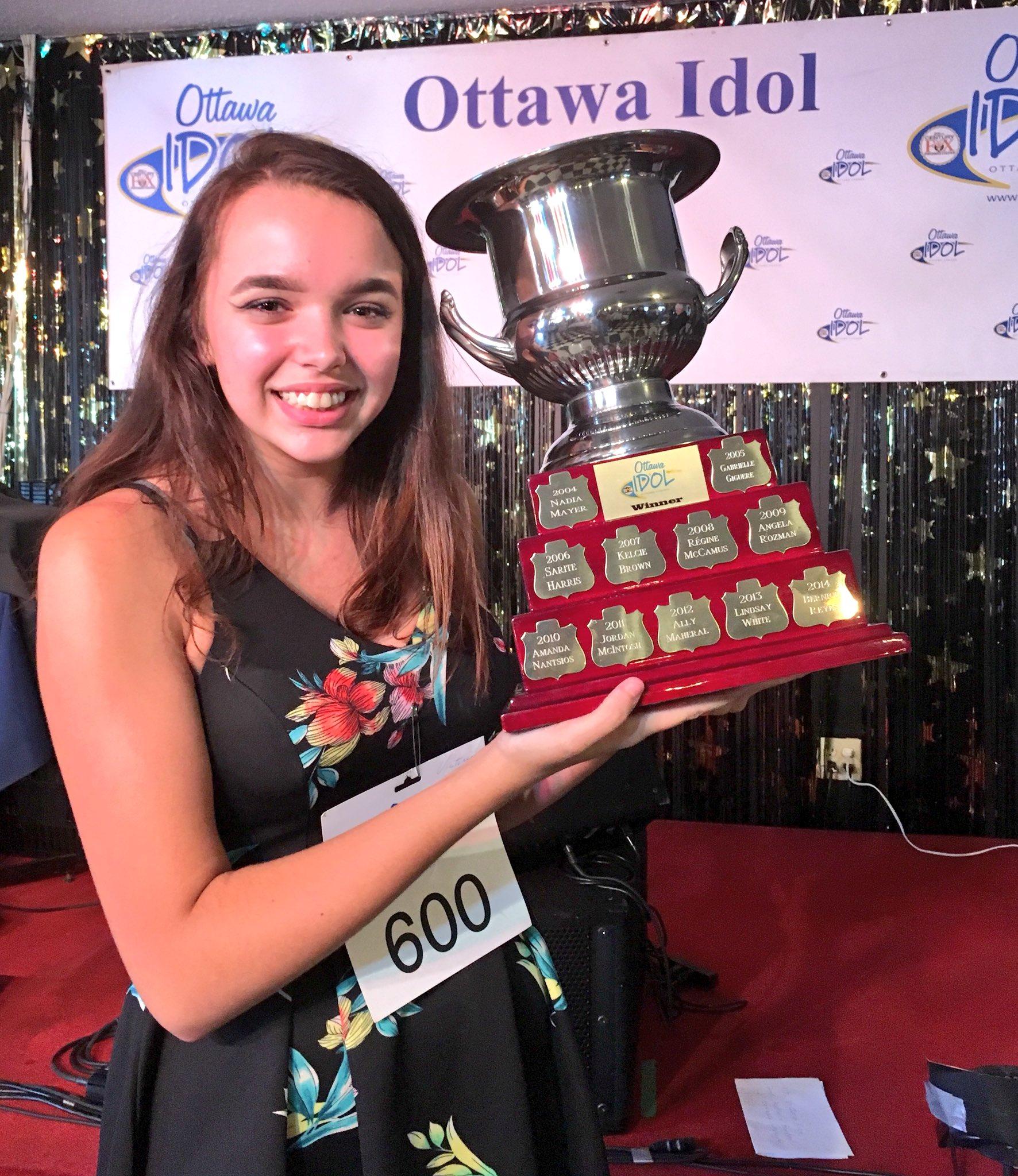 Victoria with trophie.jpg