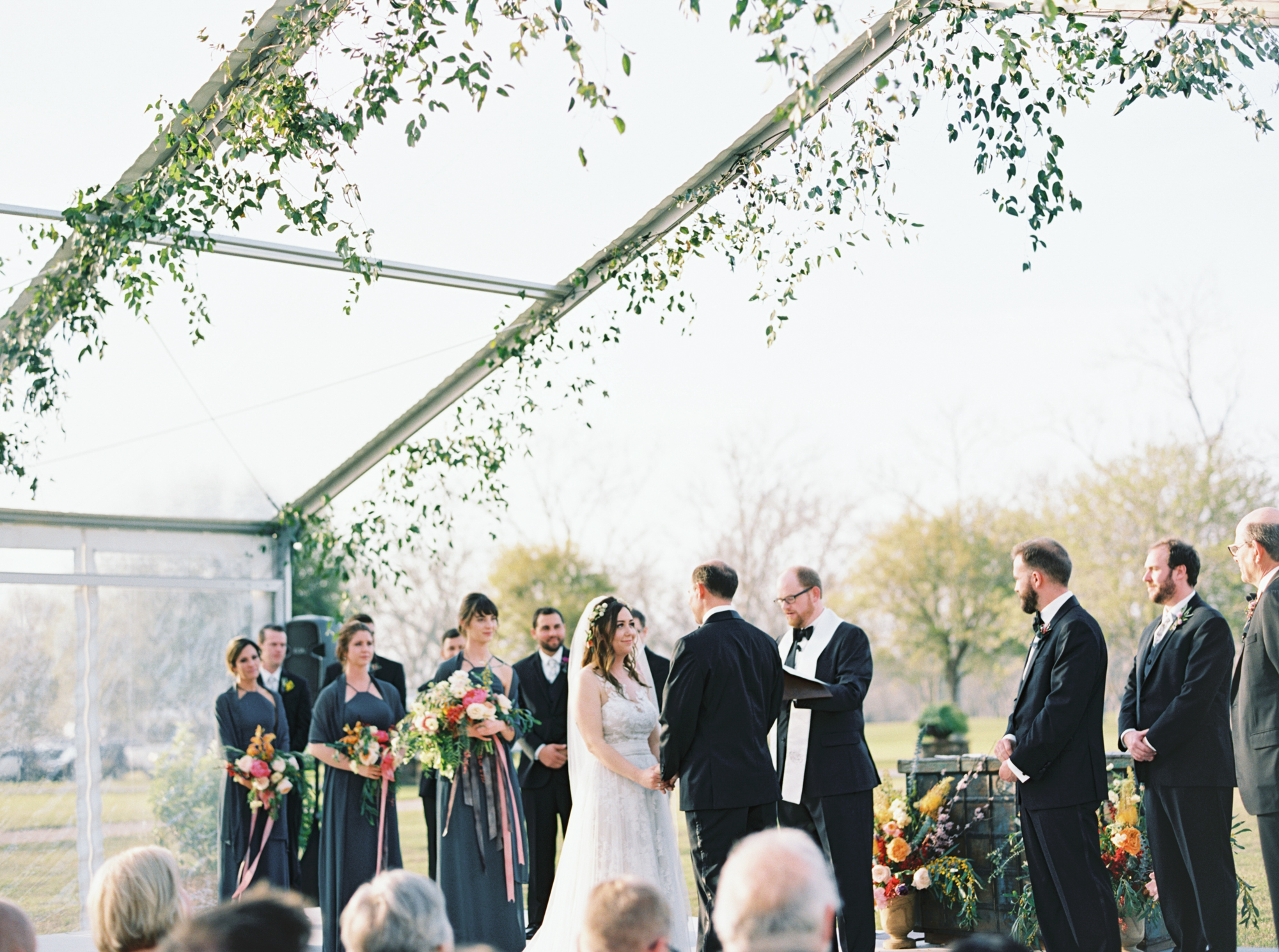 Clear tent with greenery wedding