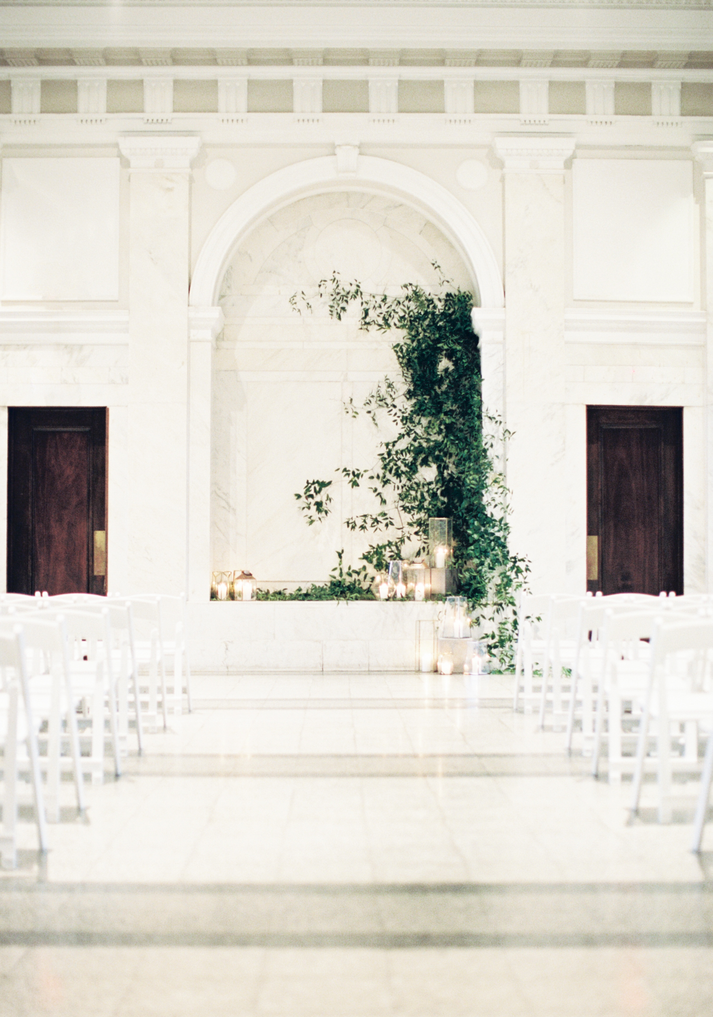 Wedding decor white marble room greenery