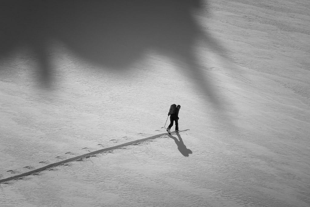 A backcountry skier climbs through fresh snow, Crystal Mountain backcountry, Washington