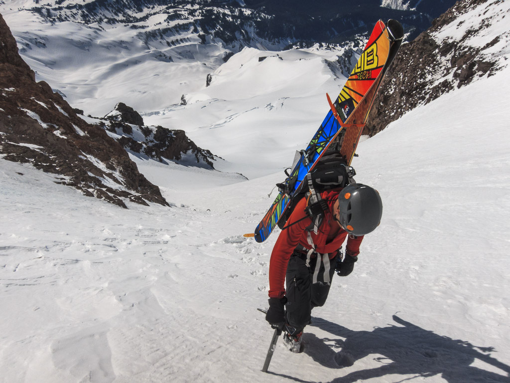 A ski mountaineer climbs the Fuhrer Finger Route on Mount Rainier, Mount Rainier National Park, Washington