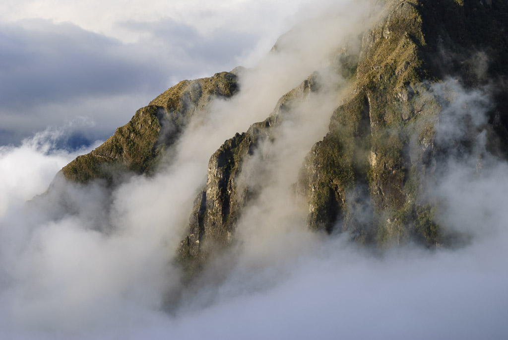 Late afternoon clouds creep up from the valley, Andes Mountains, Peru