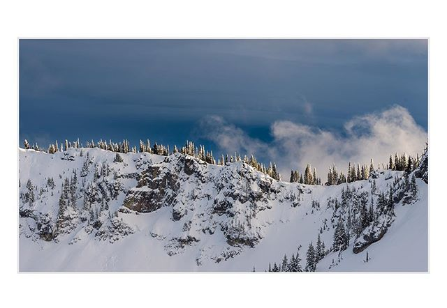 Early winter light in the Pacific Northwest has a magic quality to it.  The combination of low sun angle and dark moody clouds makes for some beautiful scenes, particularly late in the day in the mountains.  Crystal Mountain backcountry #landscape #moody #clouds @adventurejournal