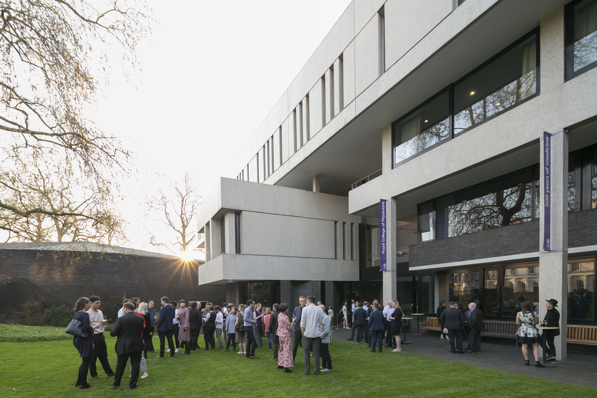 Gala guests enjoy the setting summer sun in the RCP garden