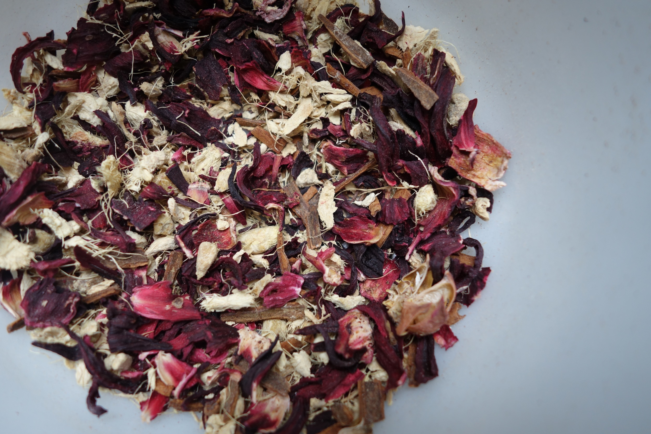 This is a digestive and purifying tonic made with hibiscus, ginger root, and cinnamon.