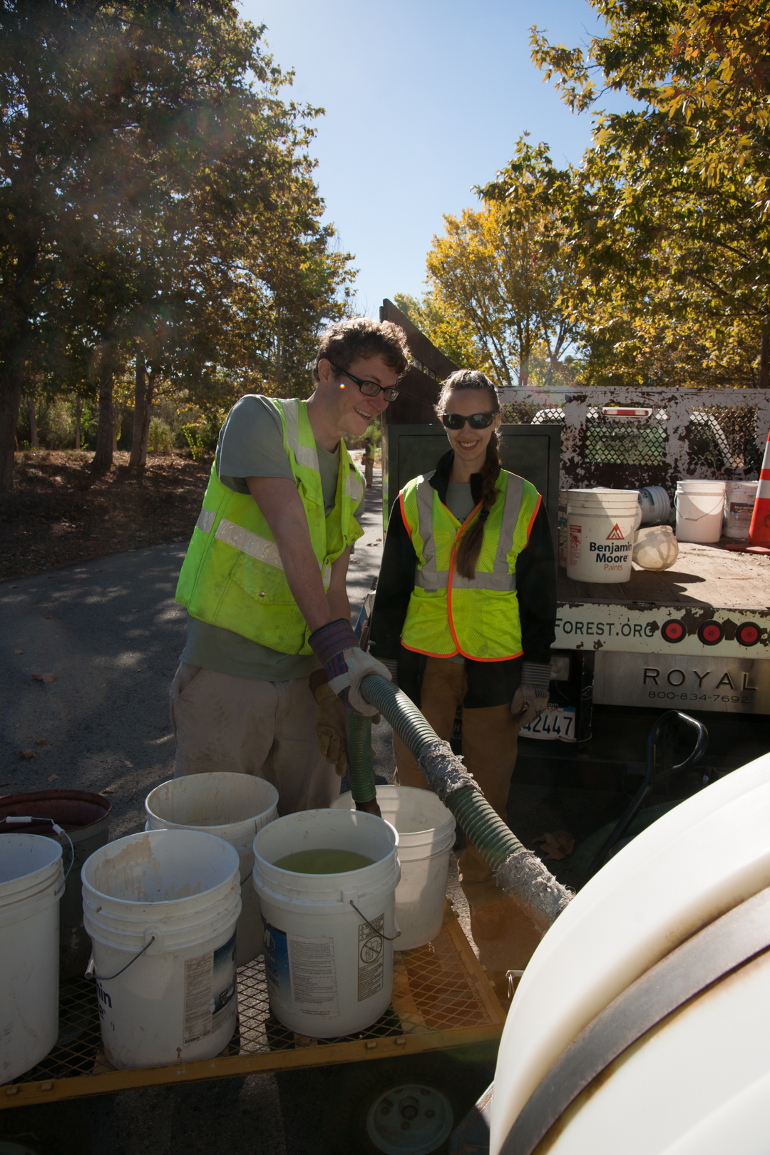 Pictured: Two OCF Americorps members watering trees in a drought