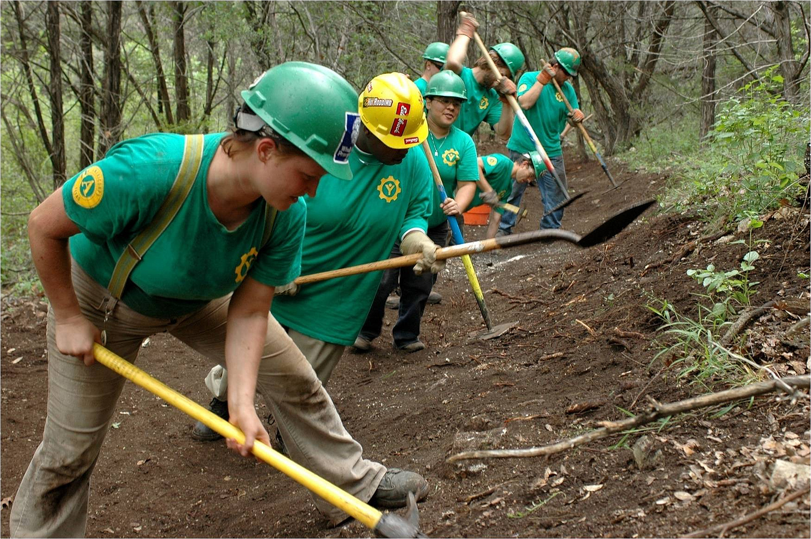 Notice the Americorps patch on the sleeves? This is an Americorps group from 2013, building trails in Texas. ( Licensed under CC 2.0 ;  source )