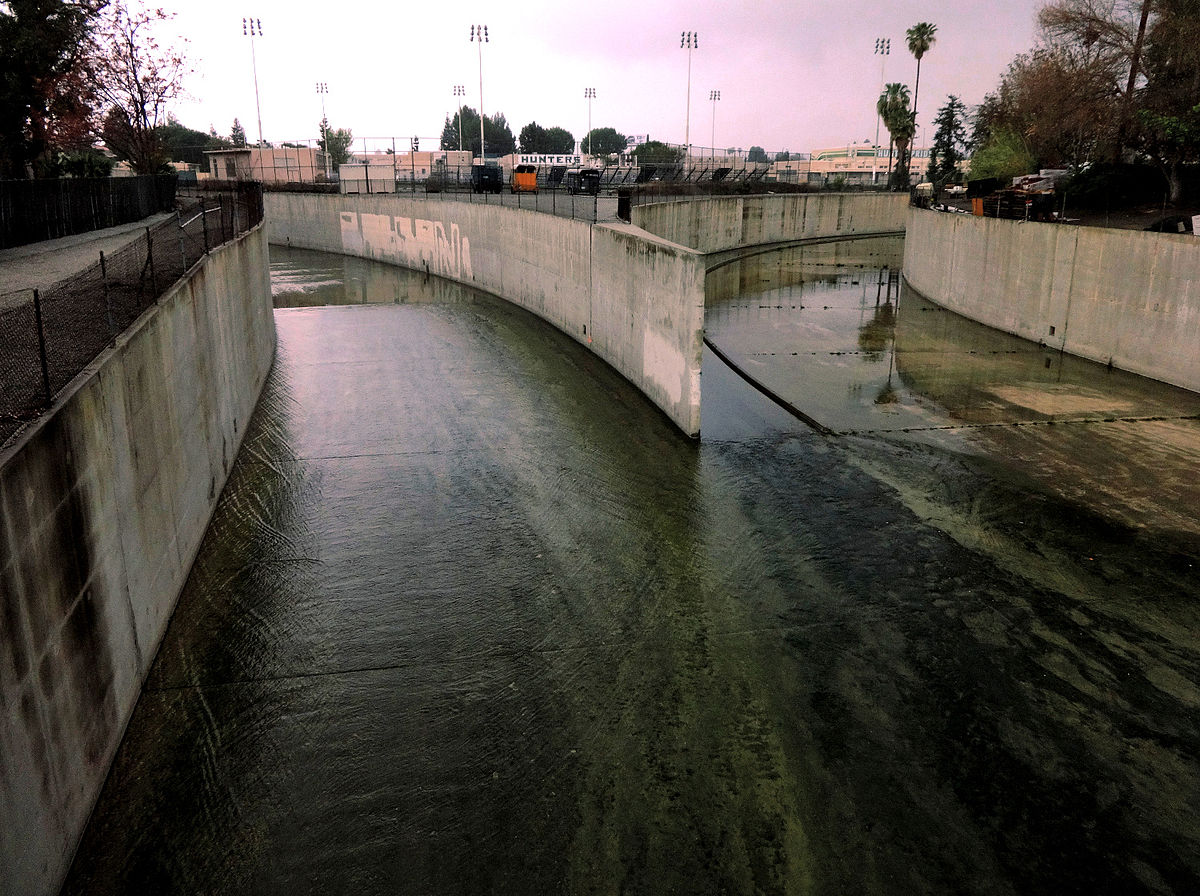 The LA River is formed by the Arryo Calabasas and Bell Creek. The head of the river is encased in concrete. (By Craig Dietrich - Flickr:  Origin of the Los Angeles River in Canoga Park , CC BY-SA 2.0, )
