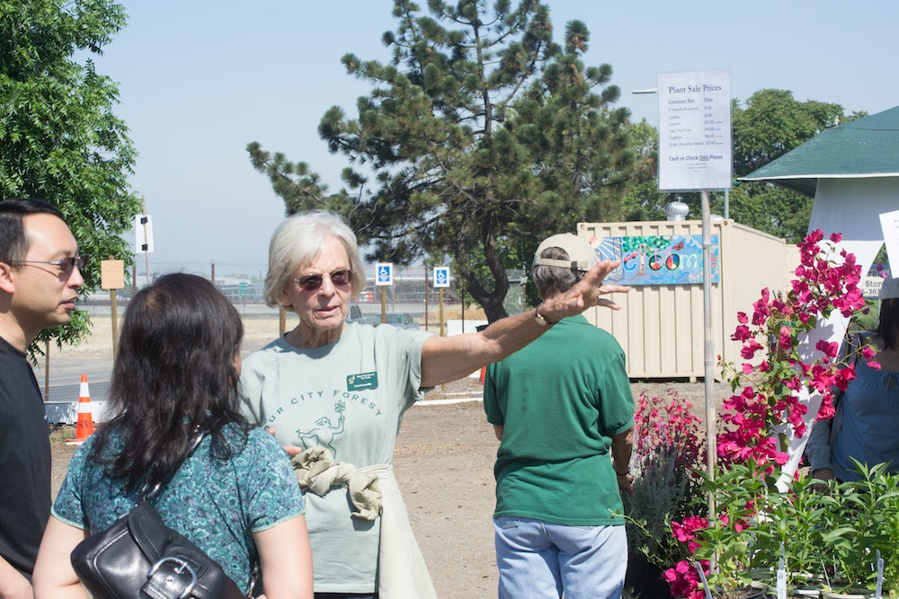 Carol Arnoldy talking to residents at the Community Nursery.