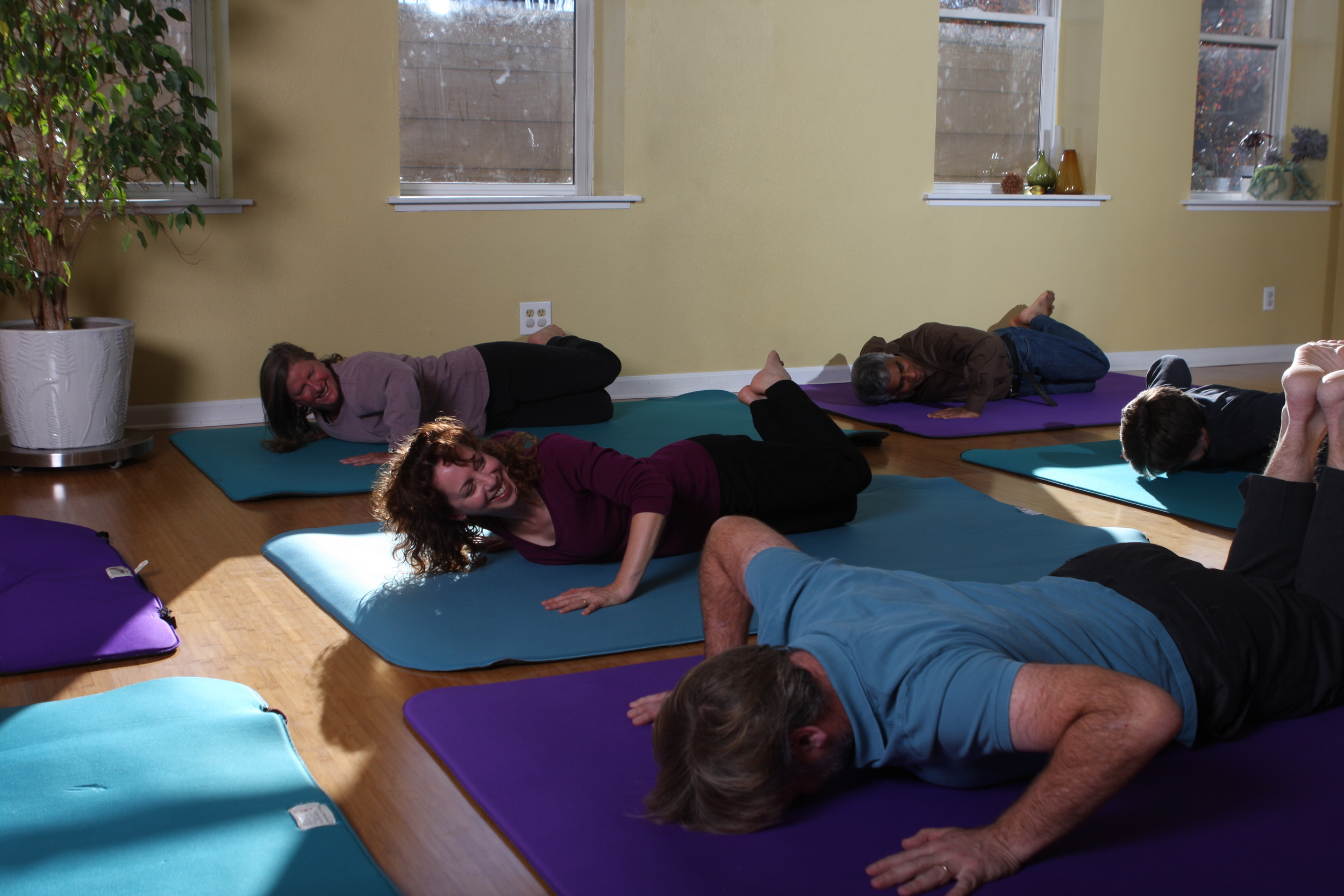 [from left]  Carrie Lafferty, Beth Cooper and others exploring effortless movement in an Awareness Through Movement class.