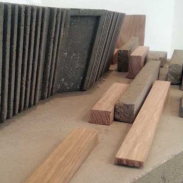 Model-making with concrete moulds and oak pieces.