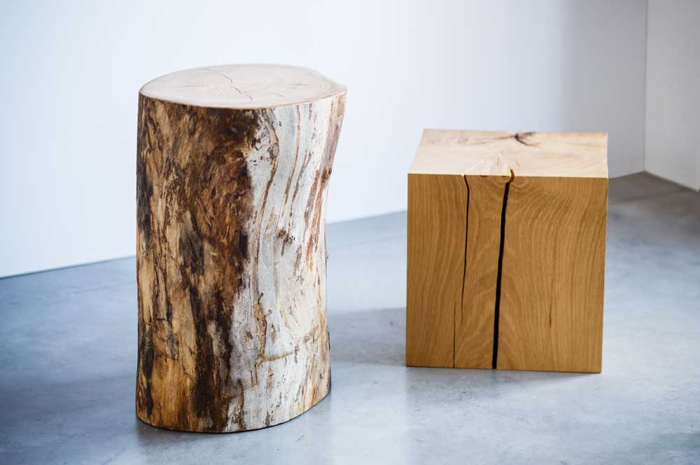 Stools from salvaged oak and tree trunks retaining natural detail.